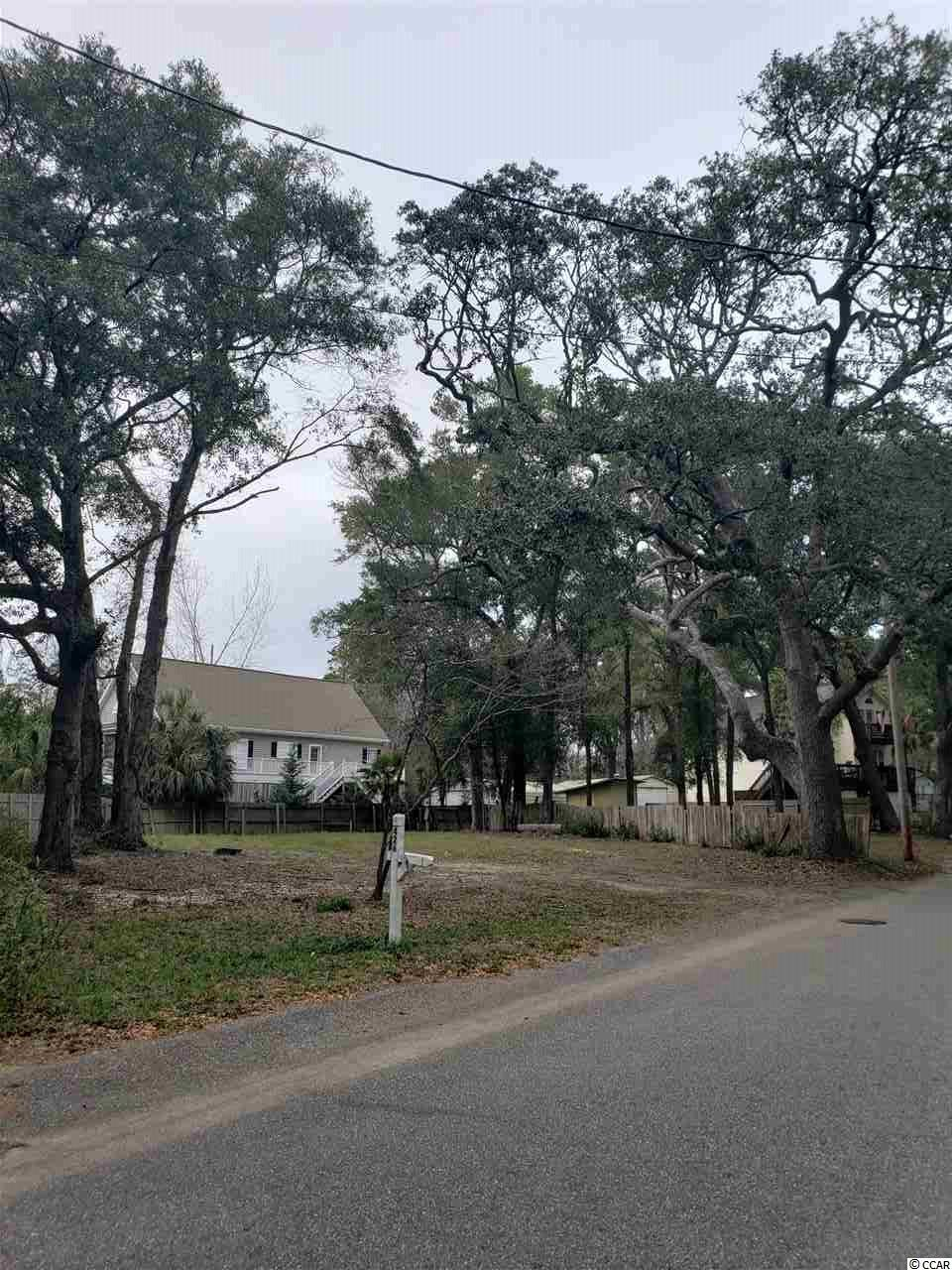 Beautiful vacant lot East of Hwy 17 Business in Murrells Inlet. Property is cleared and ready. There is a gorgeous mature Live Oak tree in the front right corner of the lot. Property is one of the highest elevations on Vereen Rd. Water and Sewer are on site. Per Grand Stand Water and Sewer, sewer line must be inspected prior to building permit being issued to confirm all is in working order. Owner is licensed SC Realtor and listing agent.