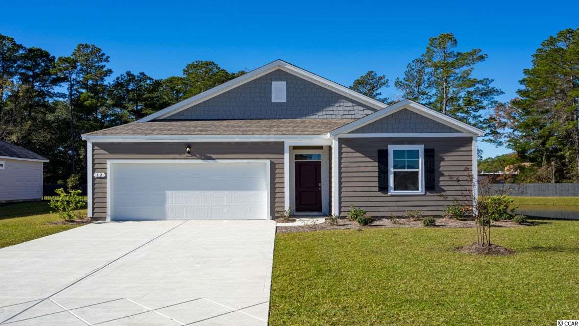 "New floorplans available in Hammock Cove! The Kerry offers one level living at its best! Featuring an open concept design, there is plenty of room for entertaining. The spacious kitchen offers 36"" painted cabinets, granite countertops, a large island with breakfast bar, and stainless Whirlpool appliances. Tons of closet storage and a spacious laundry room! The private owner's suite has a walk-in closet and en suite bath with a dual vanity and 5' shower. Covered rear porch for outdoor living. Ask about our included Home Is Connected smart home package! Hammock Cove is the place you want to call home! Just moments away from beaches, marinas, dining, golf courses, shopping, and hospitals. If you are interested in downsizing, upsizing, or if you would like to add a pool and create your own outdoor living space, Hammock Cove has the homesite and home for you.  *Photos are of a similar Kerry home. (Home and community information, including pricing, included features, terms, availability and amenities, are subject to change prior to sale at any time without notice or obligation. Square footages are approximate. Pictures, photographs, colors, features, and sizes are for illustration purposes only and will vary from the homes as built. Equal housing opportunity builder.)"