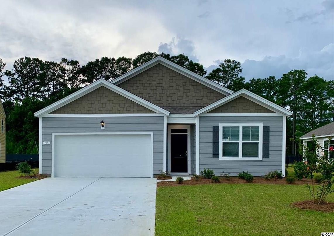 "The popular Cali floorplan is now available in Hammock Cove! This plan is the perfect one level home with a beautiful, open concept living area for entertaining. The kitchen features granite countertops, an oversized island with breakfast bar, 36"" painted cabinets, a walk-in pantry, and stainless appliances. The large owner's suite is tucked away at the back of the home, separated from the other bedrooms, with double vanity and 5' walk-in shower in the en suite bath. Beautiful wide plank laminate flooring flows throughout the main living areas, with tile in the bathrooms and laundry, and carpet in the bedrooms. Spacious covered rear porch adds additional outdoor living space. Ask about our Home Is Connected package! Hammock Cove is the place you want to call home! Just moments away from beaches, marinas, dining, golf courses, shopping, and hospitals. If you are interested in downsizing, up-sizing, or if you would like to add a pool and create your own outdoor living space, Hammock Cove has the homesite and home for you.  *Photos are of a similar Cali home. (Home and community information, including pricing, included features, terms, availability and amenities, are subject to change prior to sale at any time without notice or obligation. Square footages are approximate. Pictures, photographs, colors, features, and sizes are for illustration purposes only and will vary from the homes as built. Equal housing opportunity builder.)"