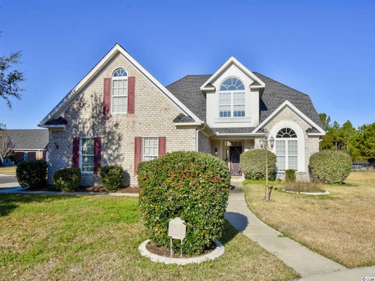Welcome home to this spacious 4 bedroom, 3 1/2 bath all brick home in the lovely Covington Lake community of Carolina Forest! As you enter you will instantly notice the soaring ceiling and large arched window providing plenty of natural light to the living space. The large kitchen has endless Corian counter space, abundant cabinetry, breakfast bar,desk area, and a cozy in-kitchen dining area. Special interior spaces include a Carolina room, a versatile room that can be used as a den, office or media room, and a beautiful loft sitting area at the top of the stairs. The Master suite has an elegant tray ceiling, walk-in closet and a private bath with dual vanities, whirlpool tub, and large shower. The second-floor bedrooms share access to a full bath. This home features 15 closets, third full bath in the garage, and a walk-in attic.  The outdoor tiled patio has a serene view of the tidy landscaped yard. Covington Lake residents enjoy a community pool, playground, and picnic area. The location provides easy access to major roads, just minutes from the beach and all the shopping, dining and entertainment the Grand Strand has to offer!