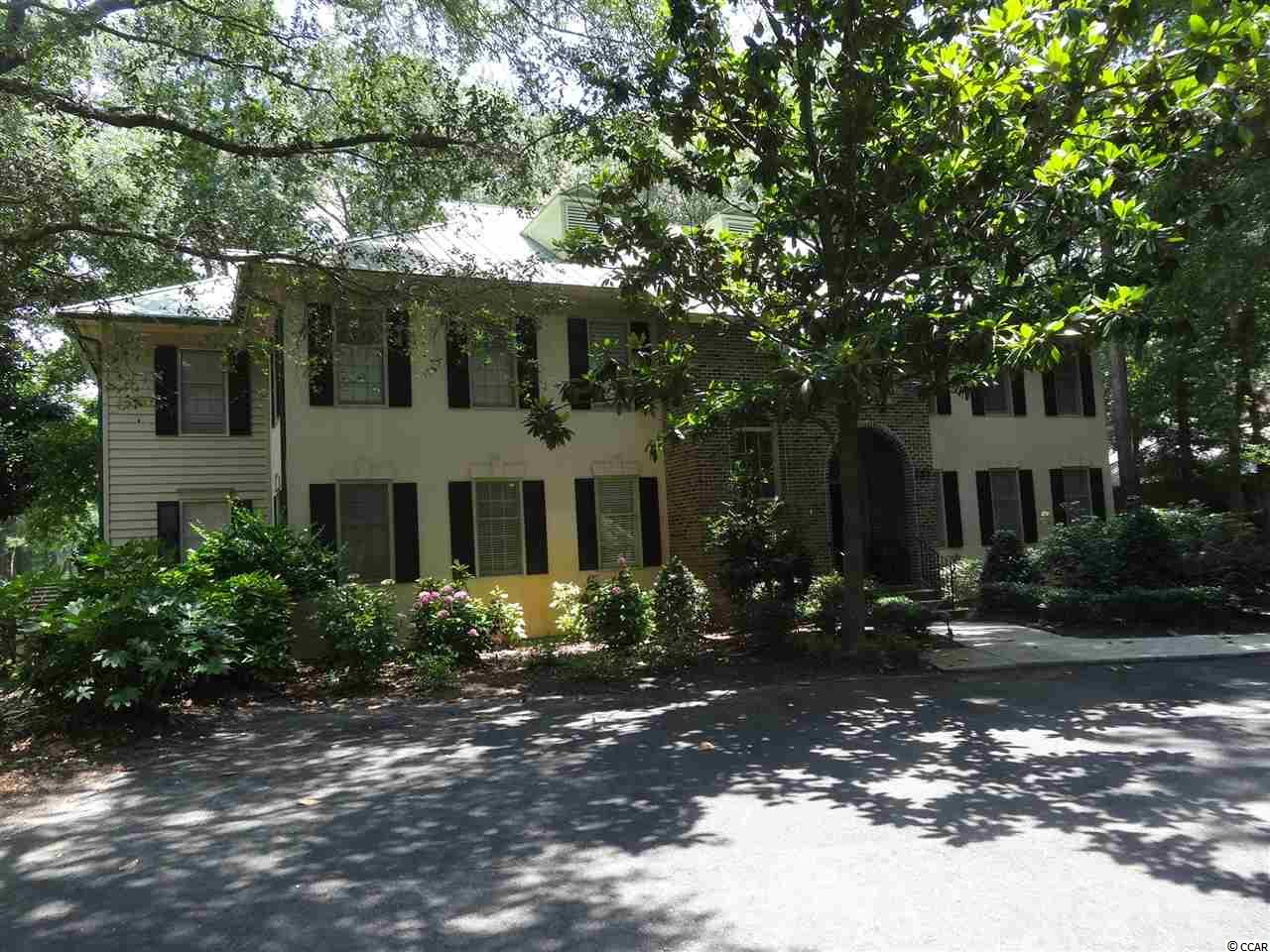 Charming 2nd floor, two bedroom, two and one half bath condo located on the 9th  fairway of Pawleys Plantation Golf and Country Club, a Jack Nicklaus Signature Golf Course, is now available. Villa offers two master bedrooms, Great-Room with fireplace (wood burning or can be converted to gas logs). Formal dining room off of kitchen is currently used as a den.  Other features include a laundry closet with washer & dryer, wet bar, large screened in porch and two decks that overlook the golf course. Wood, tile, and carpet flooring. Ceiling fans in both bedrooms, great room, and dining room.  Can be used as a primary residence, 2nd home, or rental.  Golf and Country Club Information available upon request. Historic Charleston approximately 65 miles south, Myrtle Beach approximately 25 miles north, and Georgetown 8 miles south. Pawleys Island Famous Beaches and Hammock Shops, & upscale and casual dining within minutes.