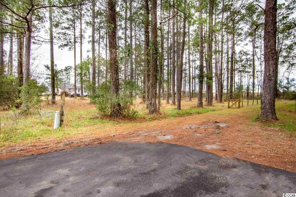 Looking for that awesome home site?? with NO HOA? This lot is close to beach, its a large Lot, and its at the End of street! So private and no traffic!  This home site is located in Eagle Nest Estates on Golf Ave! Located at the end on the left - you will see the for sale sign! Lot is semi-cleared not far from being ready for your dream home.  The lot is 125ft wide frontage and 175 ft deep - lots of room for a spacious size home and swimming pool if you desire, plus you can park all all your toys in the yard - because there is no HOA rules about that!  This area has been a locals hot spot for years and you will see all kinds of unique beautiful homes on the street. You are located in Little River and close to everything you need, Shopping, Entertainment, Schools, Churches, Beaches - Both North and South Carolina Coast! - Little River has lots to offer with the fishing village it is.. waterfront dinning, festivals thru out the year, Casinos boats, and North Myrtle Beach City limits is on 5 mins away!  There you will find the finest beaches on the Grand Strand with Lots of activity for the whole family! Summer Main Street Concerts, to the largest St Patty's Day Festival ever!  You can do lots or do nothing by grabbing your chair, book and your bathing suit as you catch some rays on the beach!  So don't buy without checking this awesome Vacant Residential Lot ready for your dream HOME.. You will love it!