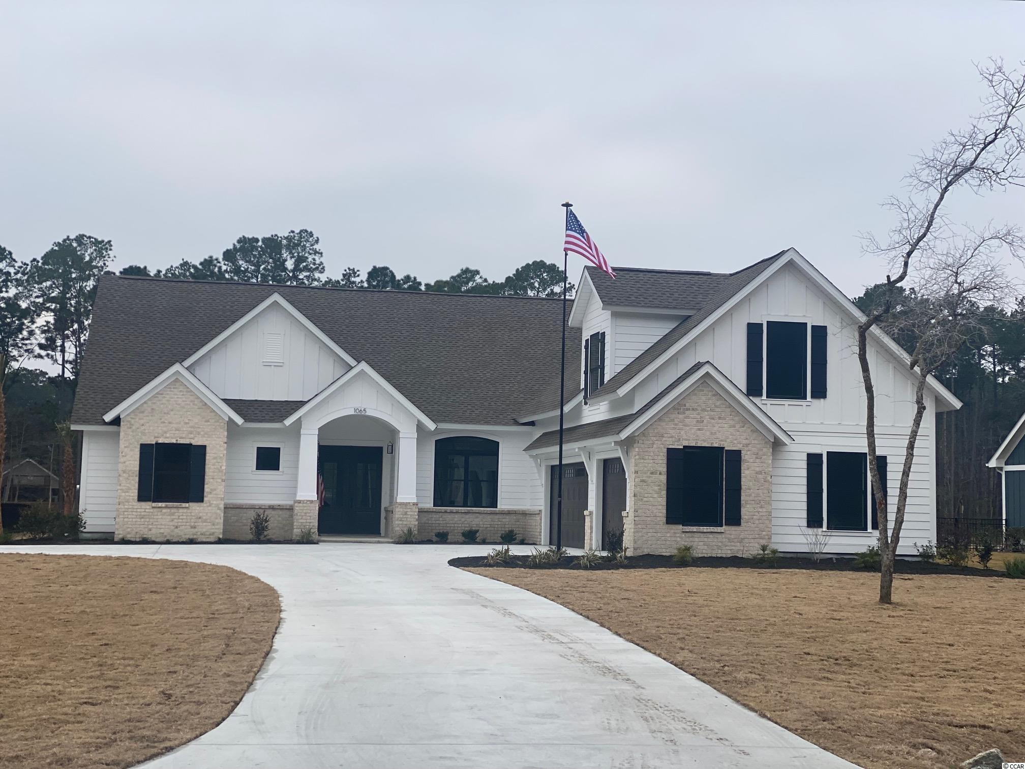 "Welcome to BEAUMONT PARK in Pawleys Island!  New development just minutes from the beach, restaurants, grocery stores and more. One acre home site with NO HOA. Custom builder. This  Carolina  home  plan s to be built with approx. 2700 Heated Square Feet.  Contemporary craftsman style 3 bedroom, 2.5  bath home with Hardie plank, shake, board & batten siding along with brick accenting exterior. An ""optional "" Bonus Room could be 4th bedroom. Bonus room is not included in listed price. This is an additional cost.  Two car attached garage.   A beautiful covered front porch plus a back covered veranda, a second covered patio off breakfast area and an additional patio off of the covered veranda!!! So many places  to enjoy your morning coffee or afternoon cocktail with friends. This home has many amazing features such as 10 foot ceilings in main living area and covered veranda,the bedrooms have 9 ft ceilings and  8 ft ceilings on second floor.  Rounded sheet rock corners, crown molding in main living areas.  An open floor plan with a large great room, dining and breakfast nook. The  Master suite has tray ceilings and master bath boosts double vanities, garden tub,  tile shower and his/her walk in closets. Beautiful interior with crown molding, tile floors throughout main living area, granite counter tops in kitchen and master bath, custom cabinets. The main living areas and master bedroom have tile flooring or hardwood flooring and other bedrooms are carpet. The additional two bedrooms are a split bedroom floor plan and a jack n jill  bathroom has cultured marble counter tops and tile flooring. Come see this beautiful home and start living the Pawleys Island lifestyle! Photos may show features NOT included in base price. Optional upgrades available upon request. .Disclaimer: Storm water plan may change to gain use of undisturbed area at the back of each lot. A retention pond will run along the back of property near property line. There will still be plenty of space for a great backyard. Please inquire for details, price is subject to change."