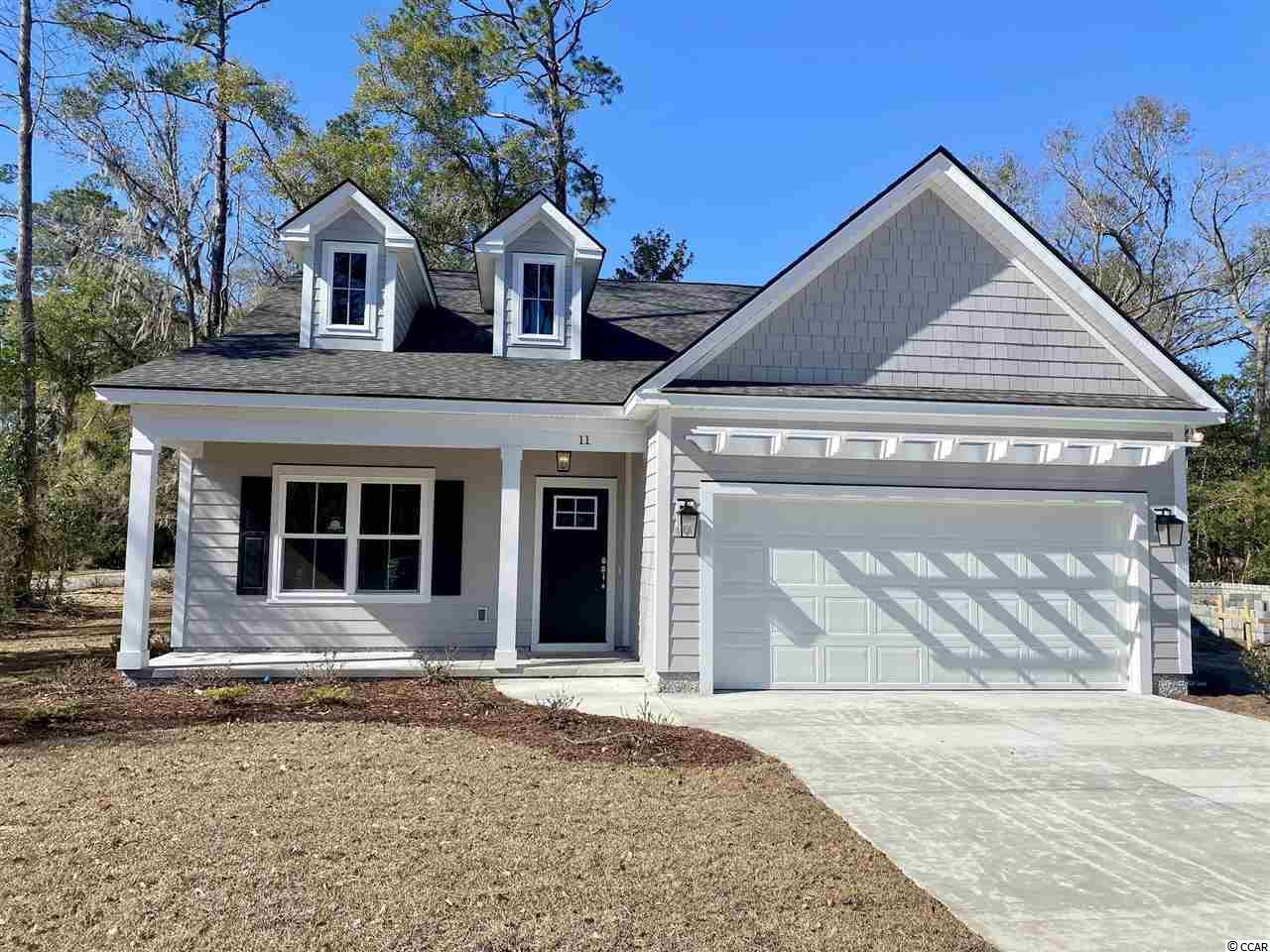 "The Indigo Plan- Located in ""Northwoods""  in Litchfield Plantation- This Beautiful floor plan boasts 9' Ceilings in the Main Living areas with crown molding, Open Kitchen/living layout with Granite Countertops, tile back splash, Upgraded Stainless steel appliances, and large Pantry. The Pinckney also offers a separate formal dining and breakfast nook.  The Master bathroom offers a separate Tub and Tile Walk in Shower, Large Walk in Closet and his and hers sinks with Granite Tops. At the rear of the home you will find a large covered porch with pine ceilings as well as a seperate grilling patio.  All of the homes in Northwoods will impress you with finish and upgrades as well as the quality of construction. Litchfield Plantation is unmatched in our area for its historic beauty. Enter the Avenue of Oaks, and you will immediately feel swept back in time. Northwoods is a brand new neighborhood located within this private and gated community that offers all of the amenities that Litchfield Plantation includes. This is a rare opportunity to own a home in truly exquisite community in Pawleys Island."