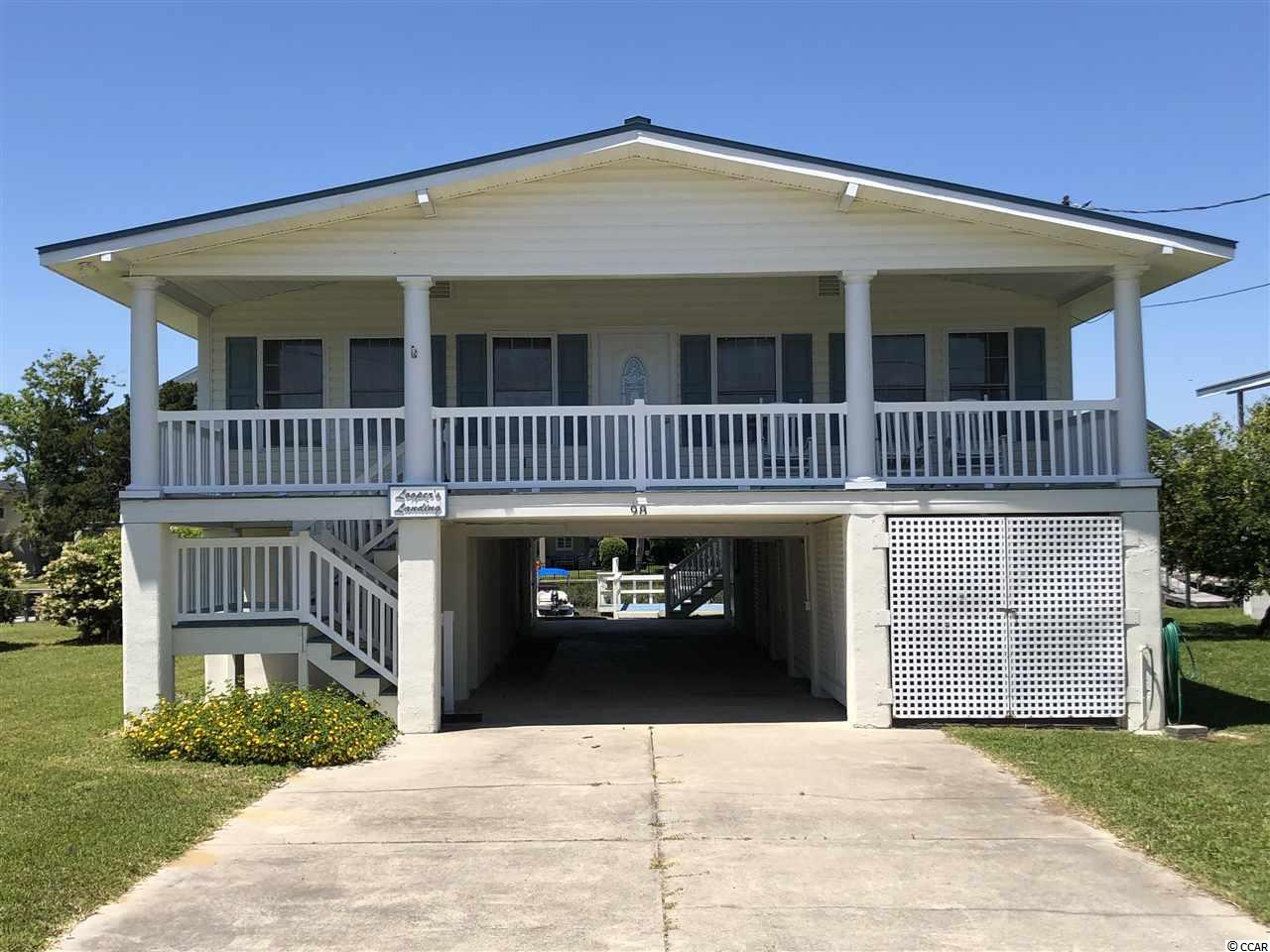 PRICE REDUCED...FIXED & FLOATING Dock in the canal w/access to the creek & Atlantic Ocean w/ Sandy Beach.  Concrete Sea Wall. Raised Beach House.   7 Bedroom/3.5 Bath. Large Master Suite.  5 Bedrooms /3 Baths on Main Floor. Family Room, DR, Kitchen w/ Breakfast Bar. 35 X 10  Front Porch. 2 Bedroom 1/2 Bath & Enclosed Outside Shower Down. Bedrooms Down have Heat & Air. Laundry Room. Tool Storage/Work shop, Boat Storage & Mower Storage under House.  Paved Driveway. Close to Beach, Fishing, Dining, Shopping and Golf.  Hurricane protection window seal. NOT A RENTAL.