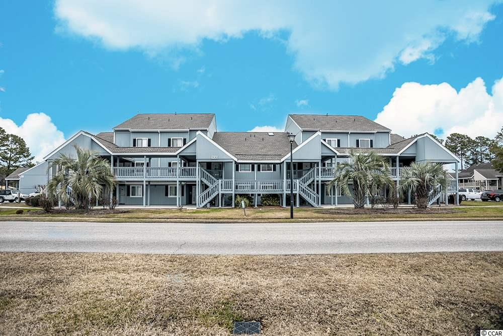 HERE IT IS! Welcome to Golf Colony at Deerfield located in beautiful Surfside Beach, SC. Golf Colony is about 2.5 miles away from the Beach. You can access both 17 Business and Bypass from this conveniently located community. There is a swimming pool located outside the unit and if you like tennis, there are tennis courts nearby. This unit is a second floor unit. The main level you will find a bedroom and full bath plus New Laminate Flooring and Paint thought out. The foyer and hallways have plenty of closets for storage and one closet houses the water heater and HVAC system.  The main living area you will find is open and spacious. A large Kitchen and lower height Breakfast Bar open to the Dining Area and Living Room. There is also a spiral staircase that leads to the Loft. The Loft is open to below and has a large walk in closet and full bathroom that has been updated with the same features as the bathroom on the first floor. You may use the Loft as your Master Bedroom as the current owner chose to do. Outside on the balcony there is another storage area and is also the laundry room with washer and dryer and extra storage. Many upgrades make this condo move in ready, but still ready for your personal touch to make it your own. Conveniently located close to Beach, Golf, Marsh Walk, shopping and dining. Call your Agent today!