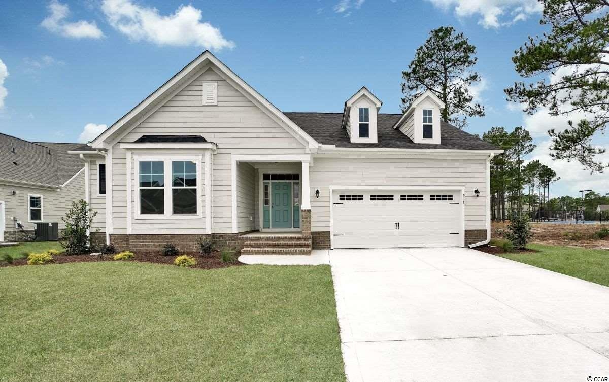 """The Ocean Isle plan has low country style with cement fiber board exteriors & raised slab brick veneer foundation.  Some standards included in this home is a large front and rear covered porch, laminate 5"""" flooring throughout all 1st floor common areas, over sized tiled walk-in master shower with seat. Natural gas water heater, gas heat. Maple 36"""" - 42"""" staggered height cabinets with crown. Quartz kitchen counter tops, counter height kitchen island peninsula with granite overhang. Tray ceiling in foyer, master bedroom & dining room. Stainless appliances, brushed nickel lighting & lighting package. Comfort height bath vanities. Upgraded trim package including 7.25"""" baseboards throughout, cased windows & openings per plan, crown in the foyer and dining room. Paver apron driveways, Fully landscaped, sodded & irrigated yard with gutters around entire home. Eco select energy program and comfort guarantee, TAEXX Built-in pest control system. Sentricon termite system. 2 - 10 warranty.  This home has been added with: Optional powder room. Upgraded backsplashes in the kitchen and butler's pantry. Single bowl SST sink. Upgraded kitchen countertops. Recessed lighting. SST gas range.   Living in Indigo Bay you will be enthralled by sites & sounds of Nature. The Home sites are centered around a 56-acre Lake where you can enjoy kayaking, canoeing, paddle boating, fishing. You will also enjoy walking through the neighborhood on our spacious 9' wide Recreation path.  Amenity center is now complete with front & rear wrap around covered & screened porches, Indoor/out side Fireplace. Community pool, Club House.  This Master Planned Community will be where you want to come home to.  Great opportunity to take advantage of Introductory Prices, see agent for details.   Pictures are actual of the home."""