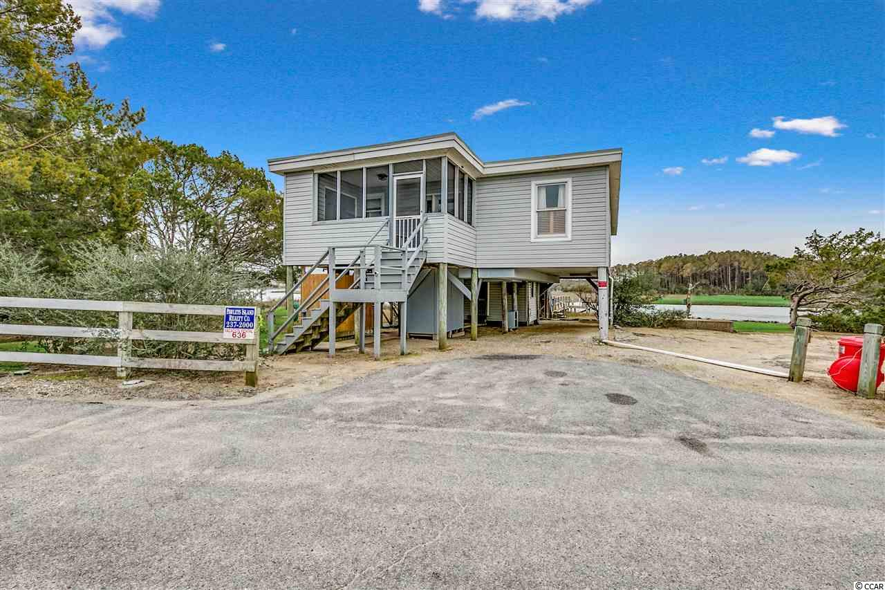CREEK FRONT home next to Pritchard Street boat landing.  This property has 314 ft. on the creek and consists of 3 separate sites of which 2 are buildable. Short walk to beach with access at Pritchard Street.