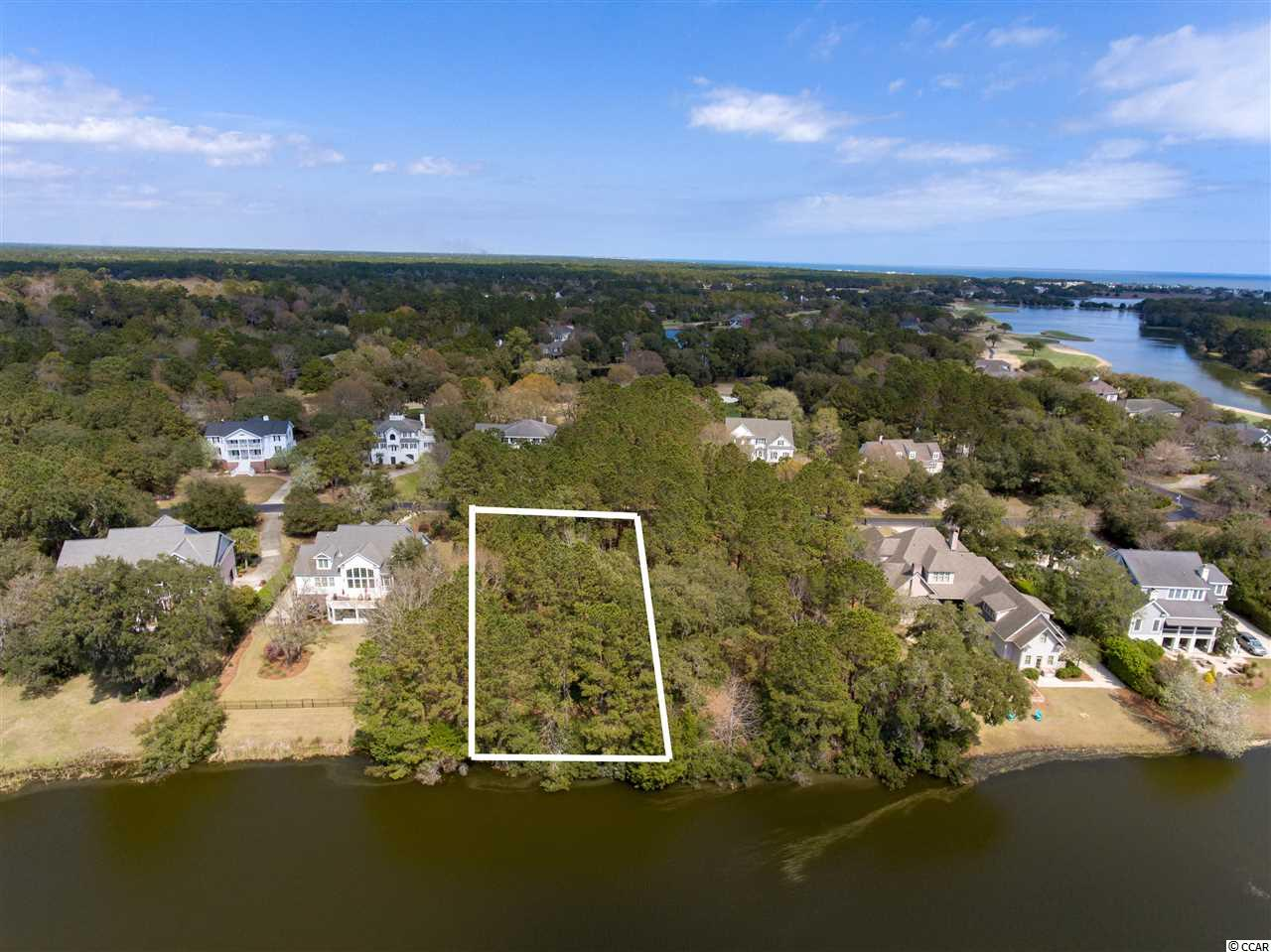 This half-acre+ lot with wonderful 4.5 acre pond frontage is conveniently located in DeBordieu's golf course community with easy access to the Clubhouse, Oceanfront Beach Club, Fitness & Tennis Center and Boat Landing. DeBordieu Colony is an Private oceanfront community located just south of Pawleys Island, South Carolina featuring private golf and tennis, saltwater creek access to the ocean, a manned security gate, and luxury homes and villas surrounded by thousands of acres of wildlife and nature preserves.