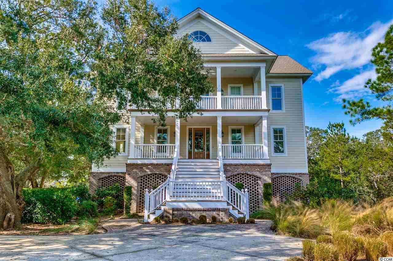 This DeBordieu Island Home is perfect for a large family (or two) that want views of the ocean, marsh, and lake! Nestled among beautifully mature live oaks, this spacious 8 bedroom, 7.5 bath home is located on the secluded south end of DeBordieu with beach access to the undeveloped 2.5 mile stretch of beach in front of Hobcaw Barony, yet just a golf cart ride away from fine dining and pools at the oceanfront beach club. The large 5200 sq. ft. open floor plan makes it easy to gather everyone together, while the two additional den/rec rooms offer space to spread out. Additional features include: Furnished, Elevator, porches, decks, lakefront setting, open gourmet kitchen, breakfast bar, granite counters, wet bar, hardwood floors, custom cabinetry, fireplace. The Square footage is approximate. Buyer is responsible for verification. DeBordieu Colony is an oceanfront community located just south of Pawleys Island, South Carolina featuring private golf and tennis, saltwater creek access to the ocean, a manned security gate, and luxury homes and villas surrounded by hundreds of acres of wildlife and nature preserves.
