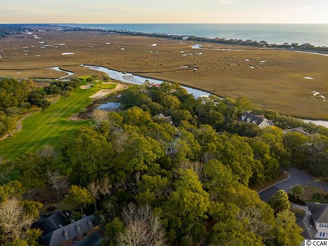 This Golden Bear lot is peacefully situated at the back of Pawleys Plantation, a beautifully landscaped gated community with a Signature Jack Niklaus golf course, pool, tennis courts, and multiple dining facilities.  This large corner home site is within earshot of the Atlantic Ocean, is just steps away from the Pawleys Island creek, and has views of Hole 16.  Lot 14 is covered in gorgeous mature oaks and other large hardwood trees. Couple all of this with ample space to build your dream home, and this address provides the best of both worlds:  serenity and community.  Spend your evenings here strolling along the marsh, listening to native birds, or enjoying a drink with your new neighbors at the local Pub which is open daily.  Pawleys Plantation is a community on the South Strand, offering (optional) social, family, and other types of golf memberships in addition to vibrant streets that are always filled with friendly faces.  Owners here also enjoy affordable HOA fees that cover many core amenities, including the security gate, trash, internet, cable, and phone.  Come visit 977 Golden Bear/Lot 14 and see why it's the ideal place to call home.