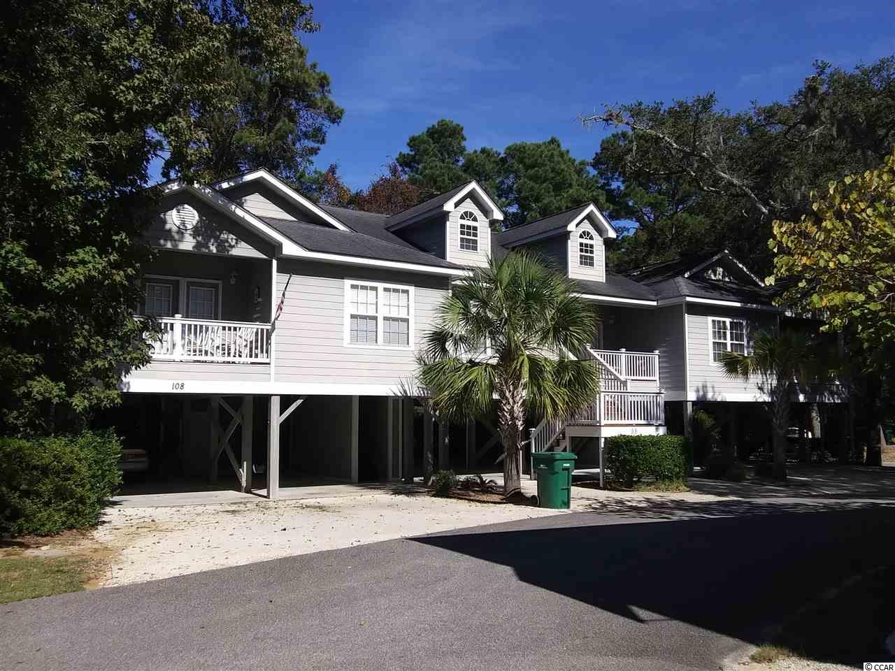 Come Enjoy this Beautiful 3 Bed, 2 Bath Raised Beach Home! Approximately 1250 Sq Ft of Heated Space & an additional 1250  sq Ft of Open space under this Raised Beach Style Home. Only Minutes from Litchfield & Pauleys Island Beaches! This Townhouse is located in a Private Community Surrounded by South Carolina's Magnificent Oaks draped in Spanish Moss, Close to All the Amenities yet has the Feeling of Living in the Country. The Home offers an Open Floor Plan with High Ceilings, Ceramic Tiled Floors in Kitchen with a Breakfast Bar, Master Bedrooms Bath & Walk in Closet, The Secondary and Third Bedroom is with a Jack & Jill Bath. Plenty of Parking Underneath the Home and Room for a Patio Setting. 2 Attached Storage Areas.