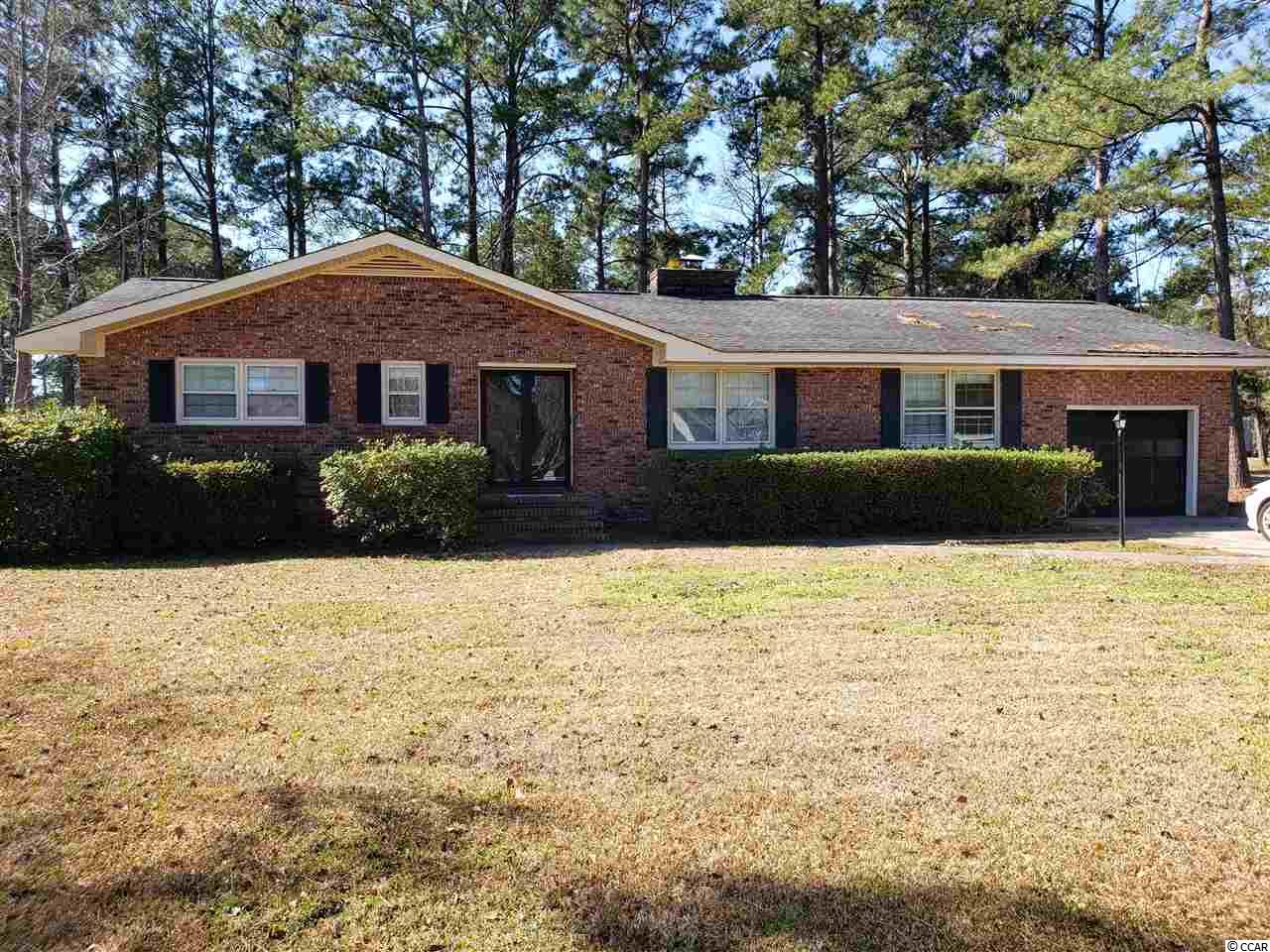 Motivated seller bring offers. 3 bedroom 2 bath brick home located in Wedgefield Plantation just outside of Georgetown. Has a large back yard. Carolina room with a golf course view. Access to Black River via community boat ramp and dock. Not far from the Historic District, shopping and dining on the waterfront. Square footage is approximate and not guaranteed. Buyer is responsible for verification.