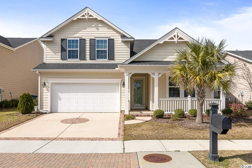Welcome home to this 4 bedroom 3 bath home in Emmens Preserve in The Market Common. This is the time to enjoy the abundant Market Common lifestyle in your Emmens Preserve home! Market Common is Myrtle Beach's first and only urban community, less than a few miles to the ocean, and airport. This home is all around turn-key ready. This home is the Crepe Myrtle Floorplan with 3 bedrooms and 2 full baths on on the first floor, with a large bedroom or bonus room and full bath upstairs. With an open floor plan, flawless hardwood floors, a ceiling fan, fireplace, bar, plentiful cabinets, granite countertops, stainless steel appliances, a breakfast nook, and formal dining room it is great for entertaining. The owners' suite is on the first floor and is very spacious, it features a tray ceiling, ceiling fan, and offer the option of natural light. In the bathroom there is double sinks, a shower, separate garden tub, and walk-in closet. Options for outside relaxation could be on the front porch or the screened lanai. Not only is this home fantastic, but so is the neighborhood of Emmens Preserve. Almost 30 acres of walking/biking trails, lakes, and parks are right outside of your door. Also outside of your door is the outdoor kitchen, green space, putting greens, and a bocce ball court. A golf cart or short walk away is the resort style amenity center that includes a playground, gym, and pool! Market Common offers abundant and diverse dining, shopping, recreational activities, and entertainment. Come and be a part of this neighborhood and community, your home awaits!!