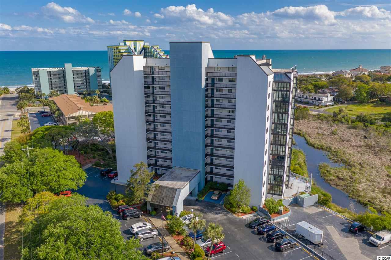 Ocean AND marsh views all at once! Welcome to the unique Sea Mark Tower. Amazing opportunity!! Located one block from the beach! Oversized balcony to soak up those views, with 3 bedrooms and 2 full bathrooms, a wood burning fireplace, and fully furnished! 1300 square feet of beach living for an amazing price!  Outdoor pool and jacuzzi on site, large deck overlooking the beautiful marsh with grilling area. Only a block from the Atlantic Ocean! Walk to the beach, boulevard, coffee shops, and dining!