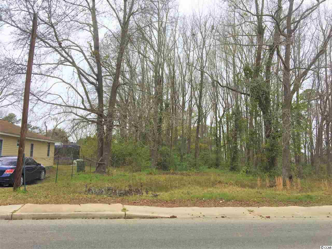 Nice lot with mature trees and 70' of road frontage.  Lot is a little over .25 acre.  Water & sewer are not hooked up to lot at this time, but are available to be hooked up by buyer.  Close to schools, grocery stores, post office, hospital, and retail!