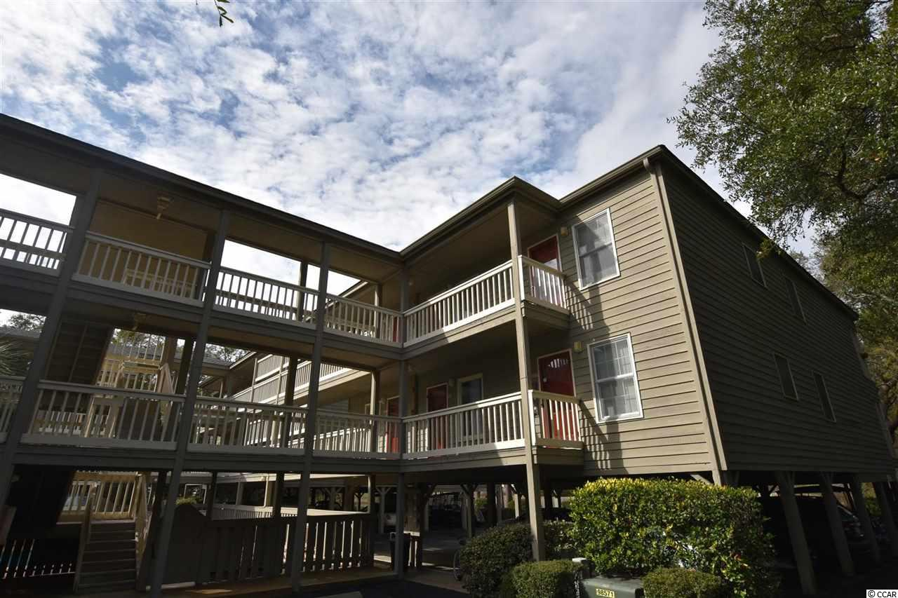 Charming is an understatement! Ocean Winds is one of the best kept secrets in North Myrtle Beach! Surrounded by mature trees and nestled away from any traffic makes it just the calming and relaxing spot you have been looking for! These units don't come on the market very often so you don't want to miss this! This 2 bedroom, 2 bath condo also offers a sleeper sofa in the living room for extra room. The screened in porch overlooks stunning trees, a pond and you can even watch the many parades Main Street has to offer in the distance. The unit comes mostly furnished, please ask for the conveyance sheet. There will be plenty to get you started and to enjoy the beach immediately! Ocean Winds offers mostly covered parking and golf cart parking (assigned). Call to schedule your showing today!  Square footage is approximate and not guaranteed. Buyer is responsible fro verification.