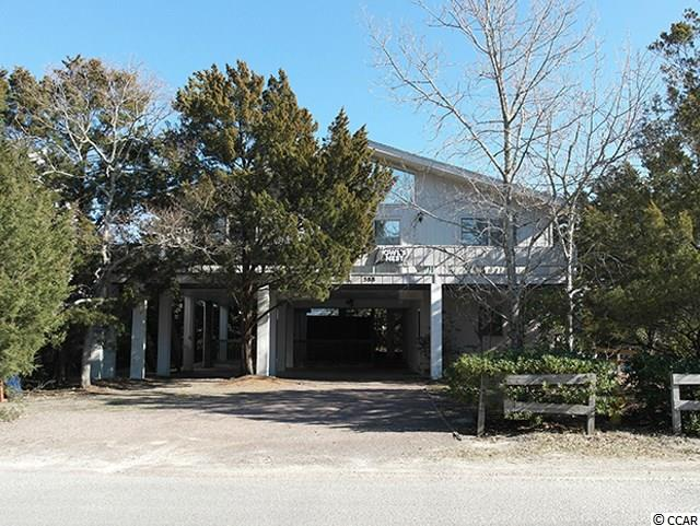 "Owl's Nest, located on 588 Myrtle Ave, is a fabulous opportunity to enjoy your own getaway on historic Pawleys Island. Built in 1977, this traditional 4 bedroom 3 bath Beach House is located in the Birds Nest area of the Island. It's strategic ""nestled"" location is within walking distance to both the Hazard Street beach access, and creekside boat landing on Pritchard Street. Upper level features of the home include full kitchen with combined living and dining area, gas log fireplace, 3 spacious bedrooms and 2 full baths. Ground floor features a private guest suite with full bath, 2nd kitchen, and private entrance. This unique arrangement offers additioanl privacy for ground floor guests.  Exterior layout includes front and back porch with ocean view, covered hot/cold shower and covered parking. There is also ample parking capability for boats. With beach and creek access at your fingertips, don't miss out on this special opportunity to expreience everything island living has to offer. This home is being sold fully furnished, and would be a phenominal investment property. Located 70 miles north of Charleston and 25 miles south of Myrtle Beach, Pawleys Island is known as one of the oldest summer resorts on the east coast. It's beautiful beaches and salt creek marshes provide numerous family activities to include fishing, crabbing, kayaking, paddleboarding and shell collecting. There are numerous boutiques, first class dining options, world class golf courses, the Historic Hobcaw Barony and Brookgreen Botanical Gardens all located within a few miles of the island."