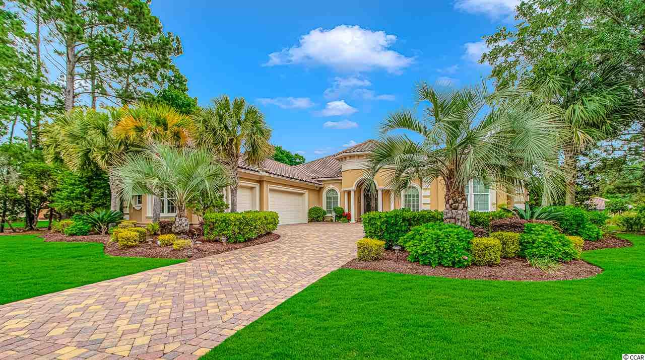 Pristine 4 bedroom 5 full bath home in the private, gated-community of The Members Club at Grande Dunes. (2 master suites) formal dining room, den/office, stone fireplace, bar, tray ceilings, granite counters, stainless appliances, tile floors, security, surround sound, huge walk-in closets, ICF Fortified.  Golf course and lake views, 3-car garage with workshop and storage.  Detached in-law/guest house. Beautiful back patio area with pool and spa.