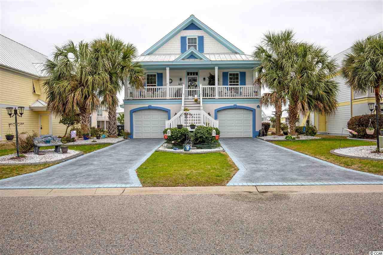 This charming, low country-style home is set among beautifully manicured grounds within a private and secure oceanfront community. This spacious home has so much room for one to enjoy - 5 bedrooms - 4 1/2 baths - full kitchen & living rooms on both the first and second floor - walk-in closets in all bedrooms - covered front porch on the front, Great views from the back deck and covered patio beneath.  Just minutes from the beach with your own private parking (golf cart or vehicle) including a great restaurant with abundant outside seating that overlooks the beach - great amenities, including swimming pools (3) one of which is heated for year-round use, state-of-the-art pickle ball court, tennis counts, shuffleboard and bocce courts, playground for kids, basketball court, a dog park, 24-hour security in a gated community. Plenty of well-stocked ponds for fishing. There is a complete fitness center and a library. Home's furnishings are negotiable.