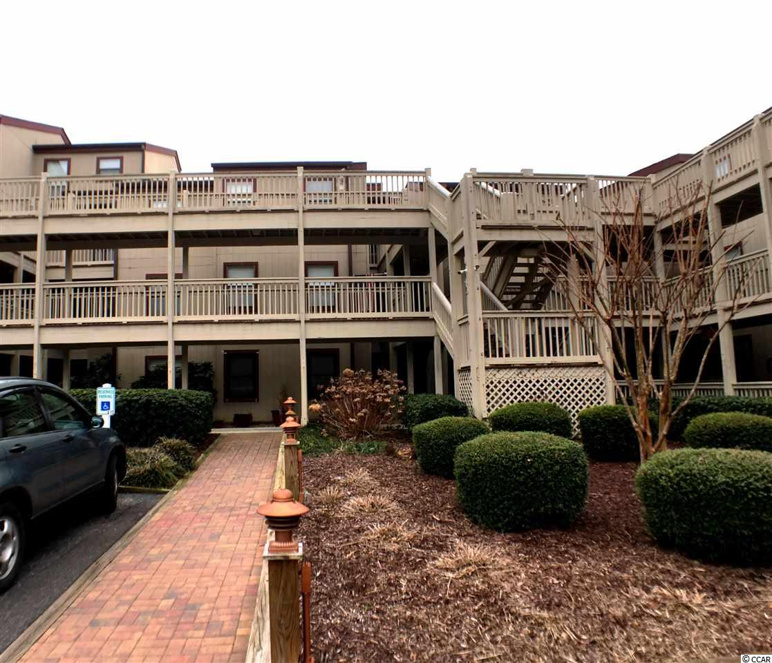 Here is your chance to own a 1 bedroom/1 bath condo on the first floor (no steps) in the highly sought-after community of Dunes Pointe, just off Shore Drive in the Arcadian section of Myrtle Beach.    Fantastic location close to the pool!  Features in this unit include a spacious living room and large dining area, a fully equipped kitchen complete with breakfast bar and a bath with vanity.  in addition, there are ceiling fans in the living room and bedroom plus lots of closed space.  The patio was converted into another room with windows and screens which adds to the living space, overlooking a park-like setting.  Located just three blocks from the beach, Dunes Pointe has amenities that include INDOOR/OUTDOOR POOLS, tennis courts, a clubhouse seating area with grills and an OCEANFRONT PRIVATE BEACH CABANA, with private restrooms. Owners are allowed to have GOLF CARTS!  Dunes Pointe is close to everything Myrtle Beach has to offer.  This condo is priced to sell - don't miss out on this opportunity!  Property is being sold as-is. Make an offer!