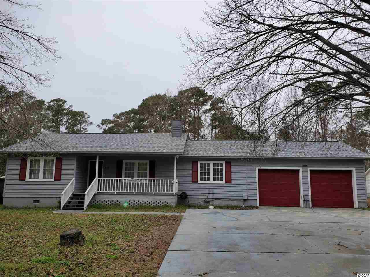 This Home is located on a couple of blocks from the creek in Murrells Inlet. Large deck on large lot with fenced in area for dogs .Over sized Garage with workshop area.Laminate flooring and tile throughout. Detached shed inside of fenced in yard.Fixer upper with lots of potential.