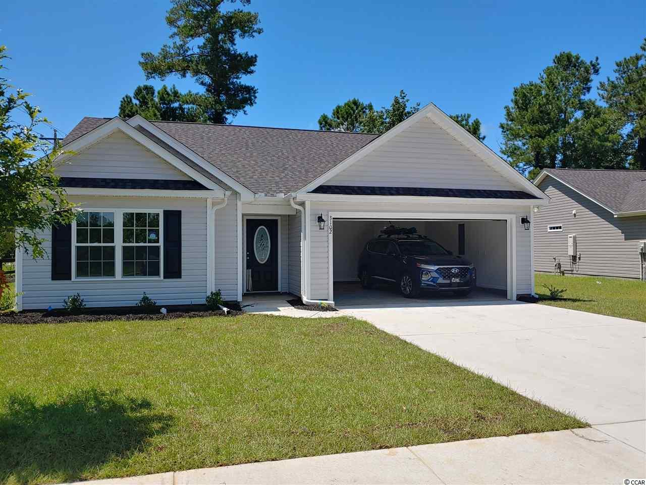 "Beautiful Sewee Plan in The New Woodland Lakes Community in The City of Conway, SC. Plan offers all of the right features and benefits.  Features include but are not limited to 3 Bedrooms 2 Baths, 2 Car Garage, ,Great Open Floor Plan, Vaulted and Trayed Ceilings, 2 Ceiling Fans, Plant Shelf, and Vinyl Windows, & Covered Rear Porch. Plans also include Separate 10x14 Concrete Patio, Sidewalks to Front Entry and Driveway. All of the Homes in Woodland Lakes Community come standard with the luxury of a Tankless Hot Water Heater, Gas Heat, Gas Stove and Oven. These new Homes also include 36"" Profiled Kitchen Cabinets with Top Molding Trim and Door Knobs, Stainless Steel Appliances, Kitchen Pantry, Linen Closet, Completely Trimmed and Painted Garage with Drop Down Storage Access, which is Floored for your convenience, and Electronic Garage Door with Remote Openers. ""Low E"" Energy Efficient Windows, Upgraded Insulation Package, Landscaped, Sodded Yard, and so much more.  All of the homes in Woodland Lakes are built with a ""Maintenance Free"" Lifestyle in mind. Woodland Lakes is South Conway's Newest Community conveniently located near Shopping, Medical Offices and Hospitals, Restaurants,  and Schools. The Builder DOES ALLOW CUSTOM HOME CHANGES ON PRESALE HOMES!  Call or visit us online today and find out why This Builder is The Areas Premier Local Builder! Other Floor Plans, Inventory Homes and Custom Plans are Available. Call the Onsite Model for New Homes Availability and to make an Appointment to see Woodland Lakes."