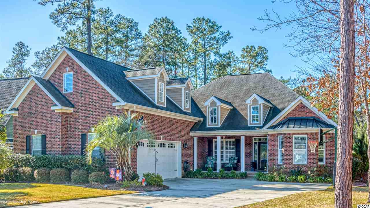 Exceptional, like-new upscale home in the prestigious Cypress River Plantation on the south side of Myrtle Beach. Gorgeous interiors for the discriminating buyer - open floor plan with beautiful wide plank hardwood floors, granite in kitchen and baths, lighting upgrades, new appliances, luxurious master bath - and many more recent upgrades. Rare to find a ranch style with four bedrooms on single level!  Huge bonus room with full bath can be used as 5th bedroom, game/media room, studio, mother-in-law or teenager suite or man's cave! Five bedrooms, 4.5 baths, awesome kitchen with breakfast area and huge walk-in pantry, spacious deluxe laundry room, formal dining room, Carolina room, oversized 3+car garage, gas fireplace in living area, woodburning fireplace in Carolina room, large fenced backyard with an outdoor entertaining paradise complete with inground pool, beach bar and grill area, firepit, and meticulous landscaping. Located on a wooded 0.6 acre private lot in this beautiful Intracoastal Waterway/Waccamaw River community, residents here enjoy the convenience of being only minutes away from all the attractions of Myrtle Beach and Murrells Inlet including fine dining, golf courses, the Marshwalk, Brookgreen Gardens, two oceanfront State Parks with miles of beachfront to explore, world-class entertainment, shopping, and marinas. Just a short drive to hospitals, medical centers and doctors' offices, post office, and the Myrtle Beach International Airport.  Amenities abound with private day docks, boat ramps, with boat, trailer, and rv storage available, tennis court, basketball court, kid's park, fitness center, large pool and clubhouse, meeting rooms, a riverside picnic park, and 24-hr gated security with sidewalks and streetlights throughout. Motorcycles, golf carts, and pets are allowed. HOA fees are low considering the extensive amenities. This home is truly one of a kind and not to be missed!
