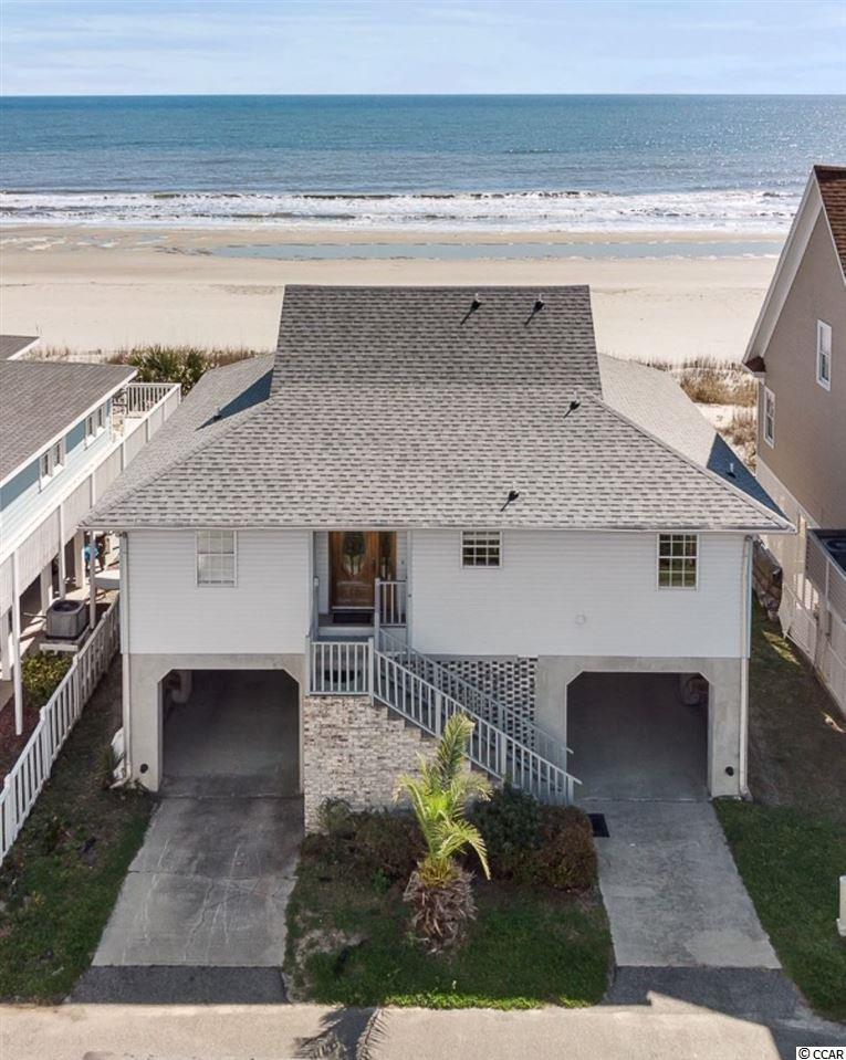BEST BUY ON THE OCEANFRONT! First Row Detached Single Family Raised Beach Home located on an interior street, 4 Bedrooms, 3 Full Bathrooms, Open concept with Panoramic Ocean Views! Large back porch provides space to enjoy the ocean breezes and views with private steps to the ocean, extra-large balcony off of the upstairs bedroom gives you 180 degree view of the beach. New Roof, 2 Showers for easy beach clean up. Parking is provided under the home for 3 cars. Large Storage room downstairs is also provided for added space. Huge Investment Opportunity for rental income or Perfect for a Beach Getaway! Drive a golf cart or walk to all that the Beach has to offer, piers, fishing, outdoor activities, dining and shopping. Welcome to the Beach!