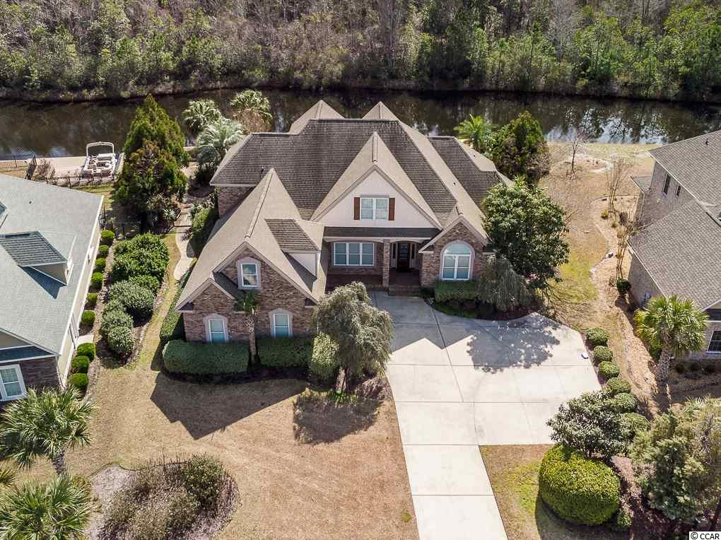 There's a new price on this Plantation Lakes 4BD/3.5BA lakefront beauty with over 3900 heated sf! Have a blast this summer in your private backyard with your in-ground saltwater, heated pool and custom paver patio and/or you can meander the 15 miles of shoreline within the neighborhood on the boat you'll be able to keep in your own private dock! Once inside, surround yourself with the various upgrades throughout including features such as coffered ceilings in the great room along with the stacked stone fireplace, surround sound and built-ins. Formal dining with tray ceiling. The kitchen overlooking the great room offers stainless appliances, granite countertops, tile backsplash, island, and beautiful custom cabinets with crown molding and breakfast bar. Move along to the expansive breakfast nook adjacent to the Carolina room with gorgeous views of nature right outside the windows! Master suite with tray ceiling, walk-in closet, double sinks plus separate vanity, jacuzzi tub, and tile shower. The office/study and second bedroom with private bath are also on the 1st level. The adventure begins anew on the 2nd level with two more bedrooms, full bath, bonus room, plus a separate media room with theater seating, projector and screen, and wet bar. Retreat to the 3-seasons room located off the great room with a view of the pool, dock and preserve on the other side of the lake. Oversize 2-car garage and a 3rd garage door to the side yard. The Plantation Lakes amenity center includes fitness room, common area for gatherings, two pools, basketball and tennis....something for everyone!  This is a short sale.