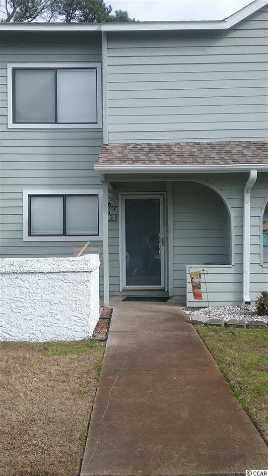 LOCATION, LOCATION.  This townhouse is within walking distance  to  grocery stores, banks drug store and restaurants.  Short golf cart ride to the beach.  Townhouse has a new kitchen with new appliances, pass thru to living    area.  Also new carpeting on 2nd floor.  Easy to see.