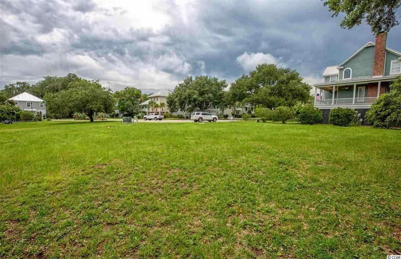 Own a piece of The Orchard, the perfect site for your future. It's cleared for you to dig in and build your dream home. This beautiful lot islocated steps away from all that Murrells Inlet has to offer, marsh walk, restaurants, shopping. If you are looking for that great lot to buildwhere you can unwind and relax, look no further!