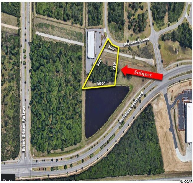 OFFERED FOR SALE is 1.16 Acres Commercial Waterfront Lot in the North Industrial Park with good exposure from Harrelson Boulevard. Property is in close proximity to The Market Common, Coastal Grand Mall, Myrtle Beach International Airport (Harrelson Boulevard), Highway 17 Bypass, and Robert Grissom Parkway. Will Build to Suit for  Qualified Tenants. IMPROVEMENTS Site consists of approximately 1.16 Acres Lot Dimensions approximately 100' x 220' x 300' x 390' Approximately 100' of Frontage on Dividend Loop Approximately 300' of Frontage Towards Harrelson Blvd Conveniently located near Myrtle Beach International Airport and Major Traffic Arteries Average Daily Traffic Count - 46,000 (Source: SCDOT 2018) - Highway 17 Bypass