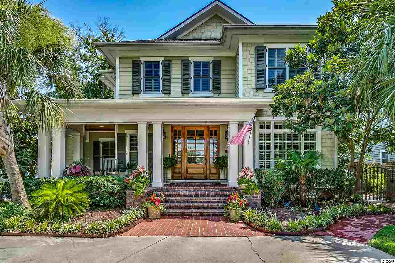 Is hospitality your passion? If so this custom beach house in the heart of North Myrtle Beach and just steps away from the ocean is the home of your dreams! With 6 bedrooms and 5.5 baths it is perfect for both indoor and outdoor entertaining. The interior features gorgeous 100+ year old reclaimed heart pine flooring out of Cannon Mills, North Carolina, mouldings and chair railings throughout, Anderson windows and doors, and plantation shutters. There are two separate Rennai tankless hot water heaters and three separate HVAC units, as well as a full house generator. The oversized kitchen boasts a six burner/griddle gourmet stainless cook top, two dishwashers, separate wet bar, and custom Savage Cabinetry out of Greenville SC. The first floor also includes a bedroom with full bath and a half bath. On the second floor you will find four bedrooms with three full baths. Head up the stairs from this floor to an additional 1200 ft. of space that has been pre-wired and plumbed for another bed and bath if desired. If you want even more room for family or friends, above the second garage you will find a beautiful bungalow containing a bedroom, full bath with custom shower, and room for overflow seating. This room has also been pre-wired and plumbed so a separate kitchen could easily be added. For outside entertaining the totally enclosed backyard is landscaped in Charleston style. There are a number of entertainment spaces and covered porches nestled among 29 custom palm trees and remarkable greenery. A custom outdoor fireplace as well as the soothing sound of the ocean completes the ambiance. And you certainly won't have to worry about guest parking with a four car garage, three separate driveways, and a golf cart parking space! Come see this remarkable home while the opportunity lasts—it will not be on the market long!