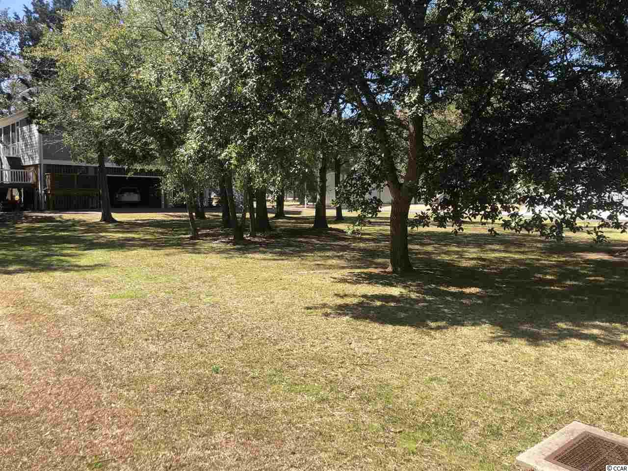 Beautifully maintained lot in the exquisite Belle Vue community. This lot is amazing and is one of the only and best priced lots available. A very short walking distance to a floating dock with a covered cabana for relaxing. Pull your boat up and swing in the amazing hammock to get the feel of this low county lifestyle or simply throw in a rod and reel and see what you can catch. Come see today why this is the place to be in Murrells Inlet, the new destination city and the Belle Vue community is the best out there. You do not want to miss this opportunity to own a slice of paradise.