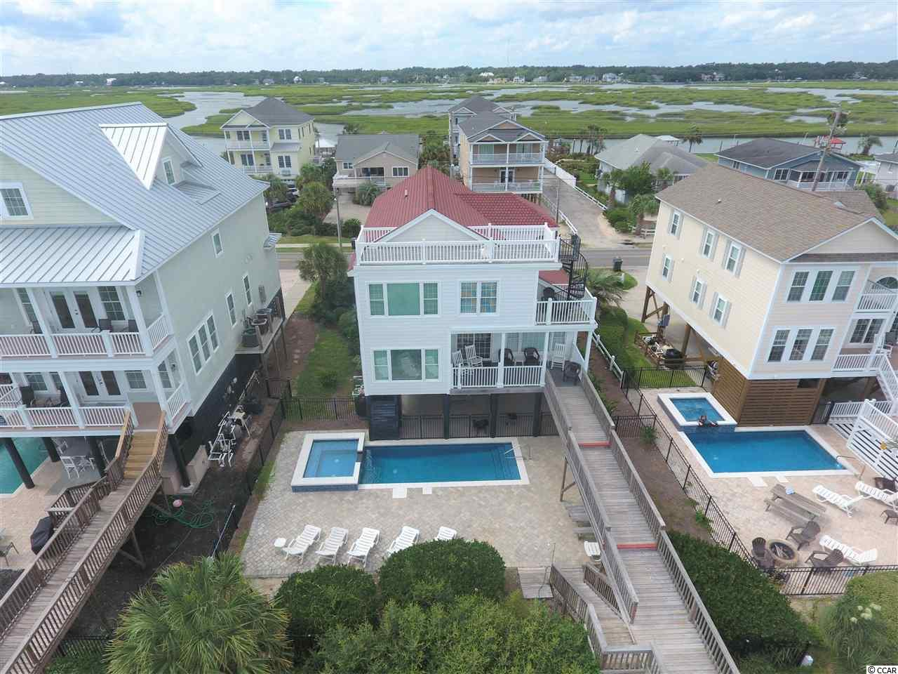 "Get ""Unplugged,"" relax and enjoy the beach!  1049 South Waccamaw Drive is located just over 1 mile South of the Garden City Pier.  This beach home features 5-bedrooms, 5 full bathrooms, which includes two oceanfront master bedrooms, a large private heated pool and roof top ""crows nest"" which boasts amazing panoramic views of the ocean, beach and creeks of Murrells Inlet.  All the amenities listed above give this property an excellent rental history!  Contact the listing agent, or your Realtor, for rental information or to schedule a private showing.  To see the 3-D Matterport Virtual Tour, click the following link: https://my.matterport.com/show/?m=9wBW2THsdmG&brand=0"