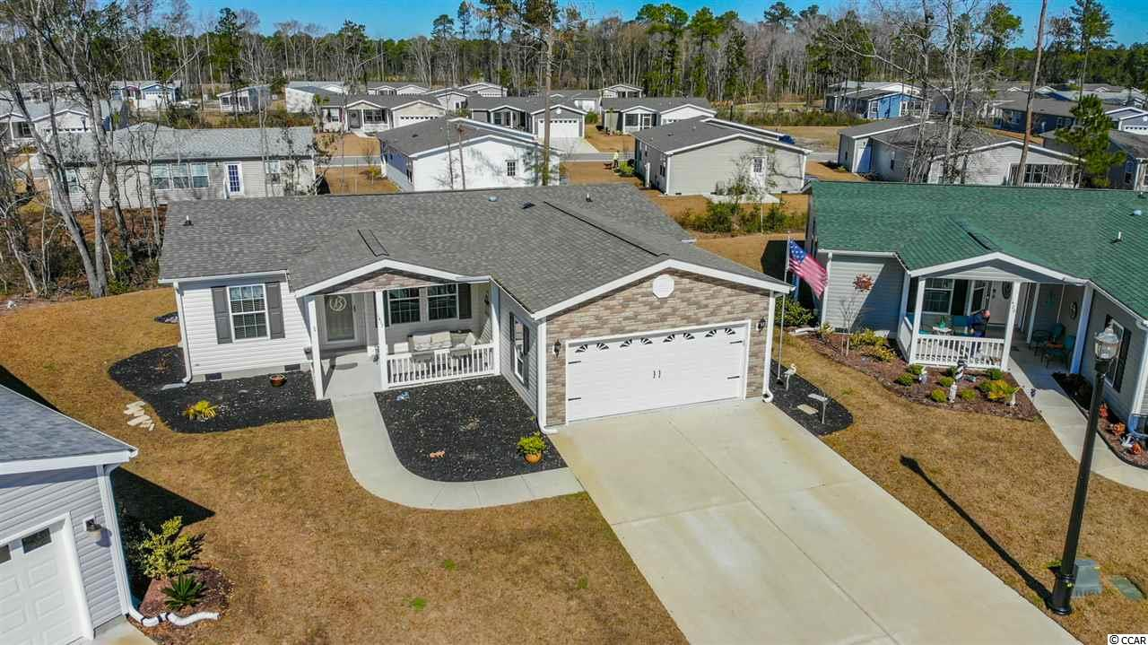 This beautifully maintained 2017 Glen Eagle floor plan is situated in a cul-de-sac just minutes from Myrtle Beach and all the area has to offer. Lakeside Crossing is a premier 55+ community- please visit the amenities center to see just how much this community has to offer! As you approach the home you will notice a manicured lawn and low maintenance rubber mulch. The large front porch has a ceiling fan and is an excellent space to relax. As you enter the home you are greeted with tons of natural light and an open feeling. There are many upgrades throughout, including fresh paint, wood floors, crown molding, storm doors, upgraded lighting and faucets, just to start. The large kitchen offers a work island, breakfast bar, and includes all appliances. The laundry room provides additional cabinet space and built-in laundry sink. The 2 car garage has epoxy floors, shelving, a fan, and a screen door! The split plan offers a guest bedroom and office space to one side, with the office providing space to convert to a third bedroom or enjoy as a bonus space. The master suite has a sliding barn door to the large bathroom- with double vanities and a massive walk-in closet. The rear patio has an awning and railing - perfect for entertaining or enjoying the quiet location. This community offers some of the best amenities in the area, including a ballroom, game rooms, library, exercise center, tennis, outdoor & indoor pools, hot tubs, arts & crafts center, full-time lifestyle director, paddle boats, pickleball, library, and so much more. You'll love everything this home and community have to offer! Square footage is approximate and not guaranteed. Buyers responsible for verification.