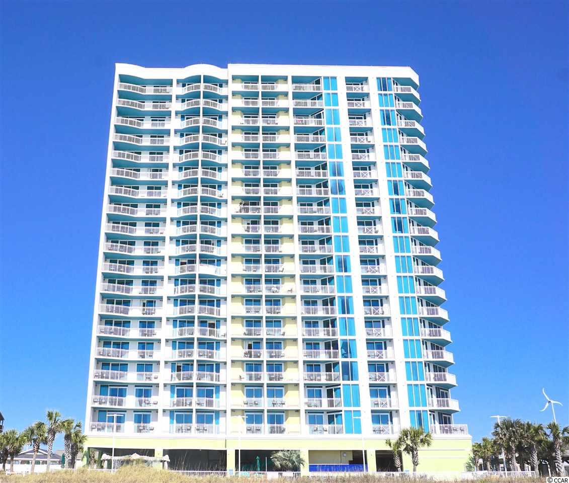 DIRECT OCEAN FRONT 1 bedroom, 2 full bath unit at Towers on the Grove. Wake up every day overlooking the gorgeous Atlantic Ocean and expansive views of the beach. Located just 1.5 miles from Main Street, 4 miles to Hwy 31 and minutes to all the attractions, restaurants and shopping that North Myrtle Beach has to offer – you cannot ask for a better location! This is not the typical layout you see in ocean front condos as the bedroom is separate and you enter through the foyer. The bedroom offers an on-suite bath with granite counter-tops on vanity, tile flooring and large whirlpool tub. The kitchen is full size with range, microwave, sink, dishwasher and large refrigerator. The cabinets are upgraded and counter-tops are granite. A second full bath with stand up shower will accommodate more guests should you decide to use the conveniently located Murphy Bed in the great room.This bathroom also boasts granite counter-tops on the vanity and tile flooring. A large great room with area for dining table and access to the ocean front balcony is the perfect place to relax or entertain.  There is a washer/dryer in the unit. This condo comes fully furnished and has a strong rental history. Towers on the Grove Is a beautiful condo building offering amenities such as pool, lazy river, hot tub, fitness center,  Grilling area, Fire pit, computer rooms and security. New HVAC Unit 2019, HOA fee includes all utilities