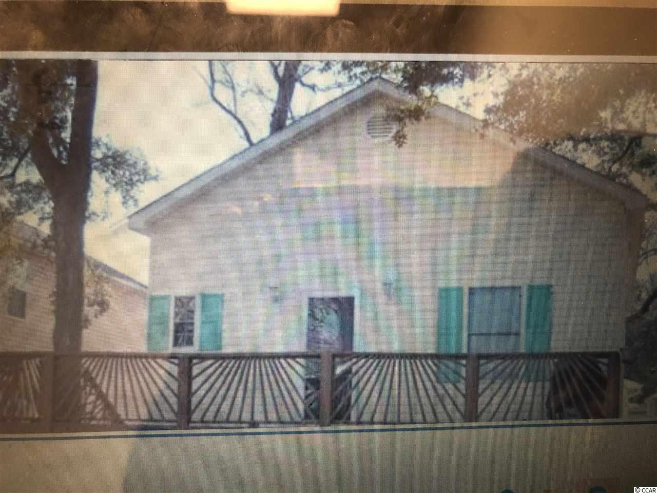 This 4BR/2.5 BA home is stick-built with one and a half stories, plus large crawl space.  Located within the prestigious and highly sought after Ocean Lakes Campground, named 2017 Best Mega Park of the Year!!  There are 2 bedrooms and 1.5 baths on the first floor; and 2 bedrooms and 1 bath on the second floor.  Vaulted open floor plan on first level to include living room, large eat-in kitchen, and breakfast bar, along with bedrooms.  Second floor has slanted ceiling with 2 twin beds and 1 full bed.  Second floor bath has shower only.  First floor bath has tub and shower surround.  Both bedrooms on first level have large closets, plus there is under-stair storage.  The home comes fully furnished, with both bedrooms on first level having full beds.  Living room has fold-out sofa, two chairs, flat screen TV, 2 bar stools and there is a small dinette set in the kitchen.  Kitchen and baths have vinyl flooring; remainder of home is carpeted.  Kitchen has white cabinets, refrigerator, smooth-top stove, built-in microwave, and dishwasher.  There are ceiling fans in the living room, and both bedrooms downstairs.  There is a large wooden, front porch, outdoor shower, and storage shed.  Small backyard, driveway accommodates two cars.  HVAC replaced approximately 2 years ago.  There are no HOA fees however there is an annual lease which covers your basic cable TV, garbage removal, security and access to all pools, water-park and all amenities that Ocean Lakes has to offer. Don't miss this opportunity to own a home along a pristine part of the beach. Easy golf cart access to shopping, restaurants, activities, and so much more.   Ocean Lakes is a 310 acre ocean front complex with 24 hour security, nearly a mile of oceanfront, Outdoor Pool, Sandy Harbor Water Park, Sandy Mart, Meet n' Eat. Come play Basketball, Shuffle Board, Horse Shoes, enjoy their award-winning Recreation program. The gated campground also features an RV Center with a store and repair technicians; Golf Car Sal