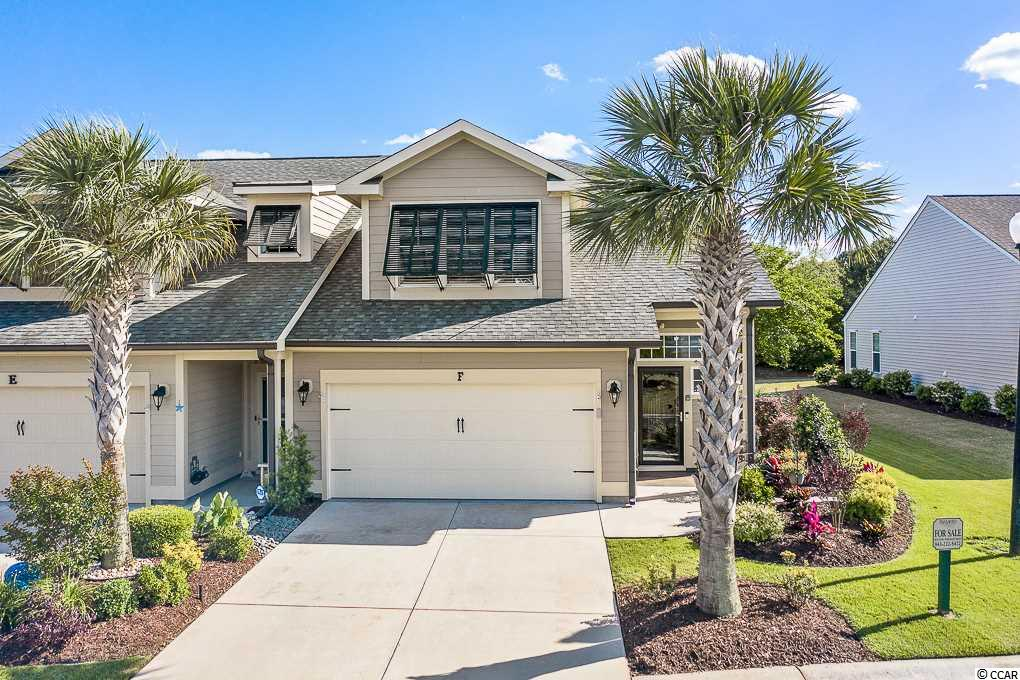 """Parmelee is located in beautiful Murrells Inlet, just 5 minutes to the historic Marsh Walk, numerous grocery stores,  and shopping.   FANTASTIC, 3BR 2.5 BA End unit townhome with MASTER SUITE on the 1st Floor and a 2 car garage.    Access with the key less entry into a lovely foyer and welcoming, comfortable Coastal-Modern decor with soft color palette.   New luxury plank flooring flows throughout,  with carpet only on the staircase.   The kitchen has two spacious breakfast bars, LG Stainless appliances including French Door refrigerator,  gorgeous granite counters,  honey colored cabinets with knobs and double stainless sink.   The kitchen also offers extra recessed lighting, a pantry and a large laundry room with shelving that houses a Front Load Samsung washer & dryer that conveys.  This open concept design has a soaring ceiling that opens up to a second story loft area and allows for socializing, from the kitchen,dining and living area.  The first floor Master Bedroom has a huge walk in closet and an en suite bath that is spa-like that includes  double vanity under mount sinks, garden tub, separate walk in shower and linen closet. A powder room is conveniently located off main living area.    The turned carpeted stair case with spindles, gives an elegant touch to this home and leads upstairs to a spacious open office or second living area.    Two large bedrooms with walk in closets share a full bath and a second laundry/storage room.    Pull down steps to attic with storage and two additional lighted storage closets are ready to accommodate.   Upgraded ceiling fans in every bedroom and living area with matching custom light fixtures throughout this fine home.    The incredible 2 car garage is crowned with a wall of NewAge lockable metal cabinetry that conveys.   The custom paint, two ceiling fans and high end epoxy finished floors host a wall mounted flat screen TV, and is the epitome of the term """" Man Cave"""".    Exit into the back extended patio area with lovely"""