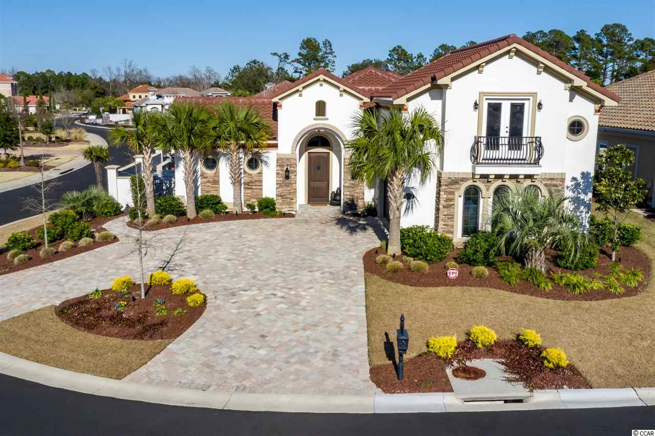 Welcome to this immaculate custom built 4 bedroom 4 bathroom home in the highly sought after neighborhood of Grande Dunes. This luxurious home has everything you are looking for including a spacious--bright and airy guest suite with several upgrades. Before entering the home you'll walk through a paved court yard showcasing the stunning pool, waterfall and professionally designed outdoor space inclusive of significant upgrades to outdoor lighting system--perfect for entertaining or simply relaxing to the tranquil sounds. The home features a designer kitchen with beautiful granite counter tops, stainless appliances, high ceilings, tons of counter space, oversized cabinets, lots of storage and a huge pantry. The living space boasts a fireplace, custom built-ins and a stunning private view of the pool with top of the line retractable sliders. As you make your way to the owner's suite you'll find beautiful tray ceilings, private access to the pool and courtyard, a luxurious bath tub, double vanity, tiled shower as well as an oversized closet. The home also provides a security system, upgraded irrigation with added efficiency in controlling running times, days and patterns and Reme Halo air purifier which disinfects and eliminates common air pollutants and odors. Grand Dunes Owners have access to a 25,000 sq/ft Ocean Club that provides ocean front pools, dining, meeting rooms and planned activities. The community also has two golf courses along with on-site restaurants, deep water marina, tennis facility and is just minutes to walking / biking trails. Don't miss out on this beautiful home in a fantastic community!
