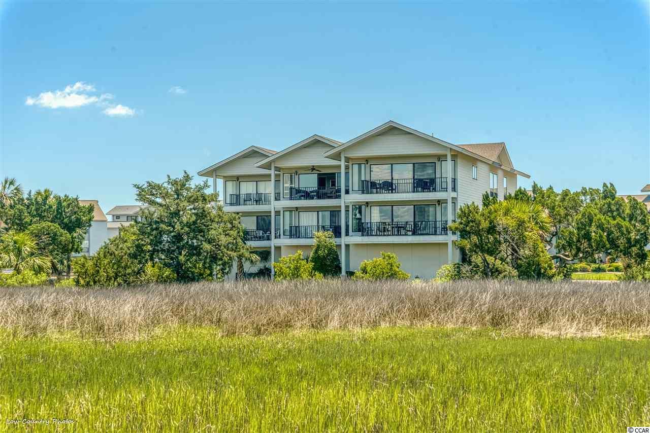 This beautifully decorated 2 bedroom, 2 bath villa is located in the gated community of Inlet Point at South Litchfield Beach. The condo sits on the top floor of the 14 building with amazing direct views of the marsh and creek. Kitchen renovation almost complete!  The spacious living area is professionally decorated with an open floor plan that flows onto porch with gorgeous views of the ever changing scenes of marsh and saltwater creek. Furnished to sleep 6 with pull out sofa in the living area. The large master bedroom has king and private bath. The guest bedroom has singles and is adjacent to the second full bath. Enjoy the amenities of Inlet Point including two pools, a crab dock on the creek and one of the prettiest beaches in SC.