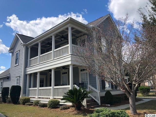 Immaculate Charleston style two story home with a beckoning porch on each level. Located in a private gated entry community that is a part of the Litchfield Beach area of Pawleys Island - within the Litchfield By the Sea Master Plan community. Reunion Hall is located a short drive, golf cart or bicycle ride from the private access to Litchfield By the Sea Resort with a Beach Club and seaside gathering deck. The homes first level offers a large gathering room with plenty of natural light, a dining room, kitchen with breakfast nook and breakfast bar, laundry and half bath room plus a convenient and generous master bedroom with an en suite bath. A few surprise updates include a deep and large stainless kitchen sink with touch activated faucet, granite counters, a hidden storage compartment under the staircase and a tankless hot water system. Flooring includes engineered hardwoods in the living areas and the master bedroom is carpeted. The second level has three bedrooms and one shared bath and there is access to the upper porch – ideal for family members and guests. A detached two-car garage has an added pull-down staircase and floored storage. Membership within this community provides additional access to tennis courts, walking/biking trails at Litchfield by the Sea and use of the pool within the River Club community. The area is home to a plethora of world-class golf courses, boating on the Intracoastal, Huntington Beach State Park and Brookgreen Gardens, restaurants, schools, medical facilities and shopping. Myrtle Beach airport is approx. 30 minutes north and Historic Charleston is 1.5 hours away. Square footage is approximate and not guaranteed. Buyer is responsible for verification.