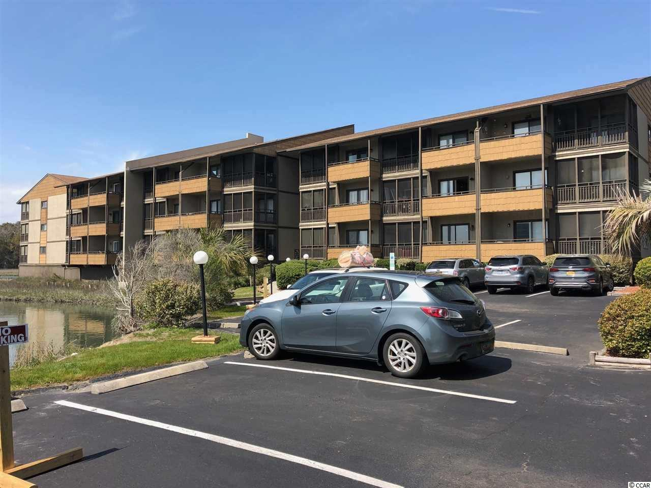 Don't miss this FULLY FURNISHED, 2nd floor, 2 bedroom unit in the quiet area of Arcadian Shores in Mariners Cove. 2nd floor units don't last long here as the buildings don't have elevators. The unit features a nice open kitchen and a living/dining room across with a very open marsh view. Unit has been very well taken care of with a hands on seller. Located in the centrally located but quiet area of Arcadian Shores minutes away from the top dining, shopping and entertainment Myrtle Beach and North Myrtle Beach has to offer. Don't miss your chance to see.