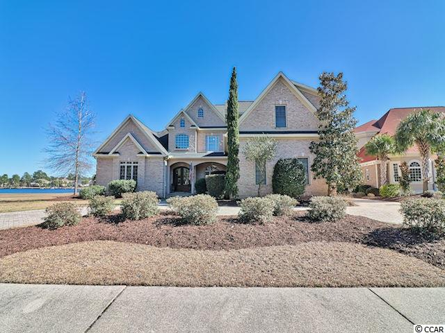 Welcome home to this spectacular custom-built, 6 bedroom, 5 1/2 bath, all brick, lakefront home in the prestigious Plantation Lakes community in Carolina Forest! This home features a vast living area with a vaulted ceiling and second-story windows for plenty of natural light and a gorgeous lake view, a modern kitchen with stainless steel appliances, endless granite counter space and custom cabinetry, and a wonderful outdoor living space on the waterfront with a private dock, fire pit, and your own personal beach. The first-floor master suite includes a tray ceiling, fireplace and sitting area, a huge walk-in closet and a private bath with a garden tub, walk-in shower, and tile floors. The five upstairs bedrooms each have their own bath. Plantation Lakes offers a large amenities complex and navigatable waterways. The location provides easy access to major roads, just minutes from the beach and all the shopping dining and entertainment the Grand Strand has to offer!