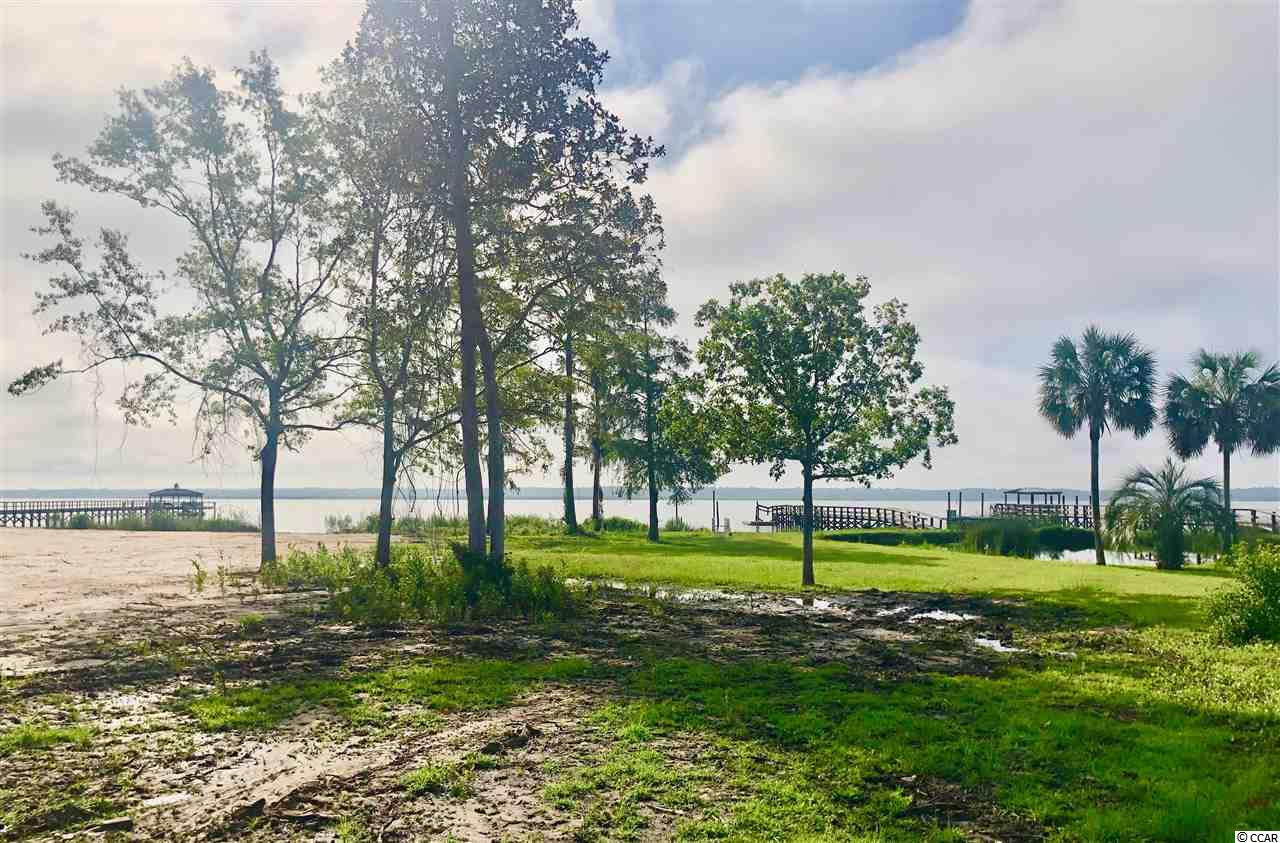 You will not find a nicer view of Winyah Bay and the Intracoastal Waterway. This is a rare opportunity to own 1.48 acre lot, with 100 ft of waterfront and breath taking views. This property is zoned with a conservation preservation on the marsh, which preserves a water view forever. A dock may be built with the correct permits. Located just south of the Historic District of Georgetown and a short drive to the beautiful beaches of Pawleys Island. You are also 1 hour from Charleston or Myrtle Beach. This land has been cleared and is ready for you to build your dream home!