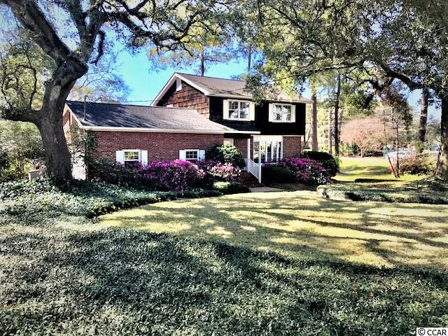 Beautiful setting for this wonderful one owner family home. Lots of azaleas make for a beautiful setting for this 2 story brick home with formal areas as well as a family room with fire place, exposed wood beams and wood floors. Enjoy the very bright Carolina Room with built ins and desk area. Nice foyer leading to a bright kitchen with exposed brick. Lots of potential with this home in much desired Country Club Estates. Full house generator for your convenience during storms. Close to hospital, medical offices, and shopping.