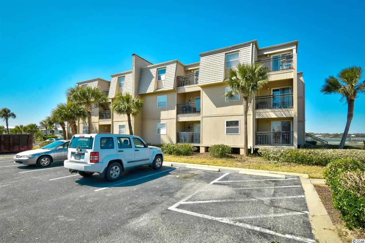 Welcome to this fully furnished, 2 bedroom 2 bathroom unit in the highly sought after community of Inlet Pointe in Garden City. This unit features a spacious open floor plan of the main living areas with well coordinated furnishings throughout. The kitchen is equipped with all appliances, updated countertops, and a dining area that seats 4. Each bedroom includes plenty of closet space, a ceiling fan, and access to its own bathroom. Enjoy the views from your 3rd floor balcony, and spend your afternoons relaxing at the community pool overlooking the inlet, or at the beach just across the street. Inlet Pointe is a private gated community with a pool, onsite laundry facilities, grill and picnic areas, and private access to docks on the inlet. Located just a short drive to the famous dining and shopping of the Murrells Inlet Marsh Walk, and close to all of the Grand Strand's finest dining, shopping, golf, and entertainment attractions. Whether you are looking for an investment opportunity or a second home at the beach,  you won't want to miss this. Schedule your showing today!