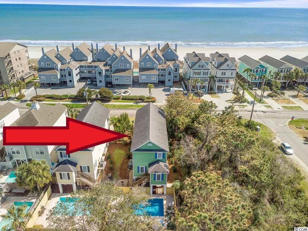 Four-bedroom, 4-bathroom second row beach home featuring a 14' x 24' private heated swimming pool.  Recently remodeled and professionally decorated with a colorful coastal theme, this vacation rental home is setup to sleep 18.  Second living/sitting room could be converted into a 5th bedroom.  Located in the highly desirable family-friendly Surfside Beach, just a half mile north of the pier.  Easy beach access across the street.  Two levels of ocean facing covered porches to relax and enjoy the sea breeze.  Open floor-plan with many recent upgrades by current owners: new wood flooring, new carpet, new living room furniture, paint, granite counters, new stainless steel appliances, new washer & dryer, custom master bathroom with granite vanity and tile shower, new bunk beds & mattresses, new pool heater, new fencing and landscaping at pool area, new exterior furniture.  Being sold fully furnished, rental ready.  Rental history and bookings to date for 2020 available upon request.  Enclosed outdoor shower and storage room under house.  Concrete driveway with covered parking.