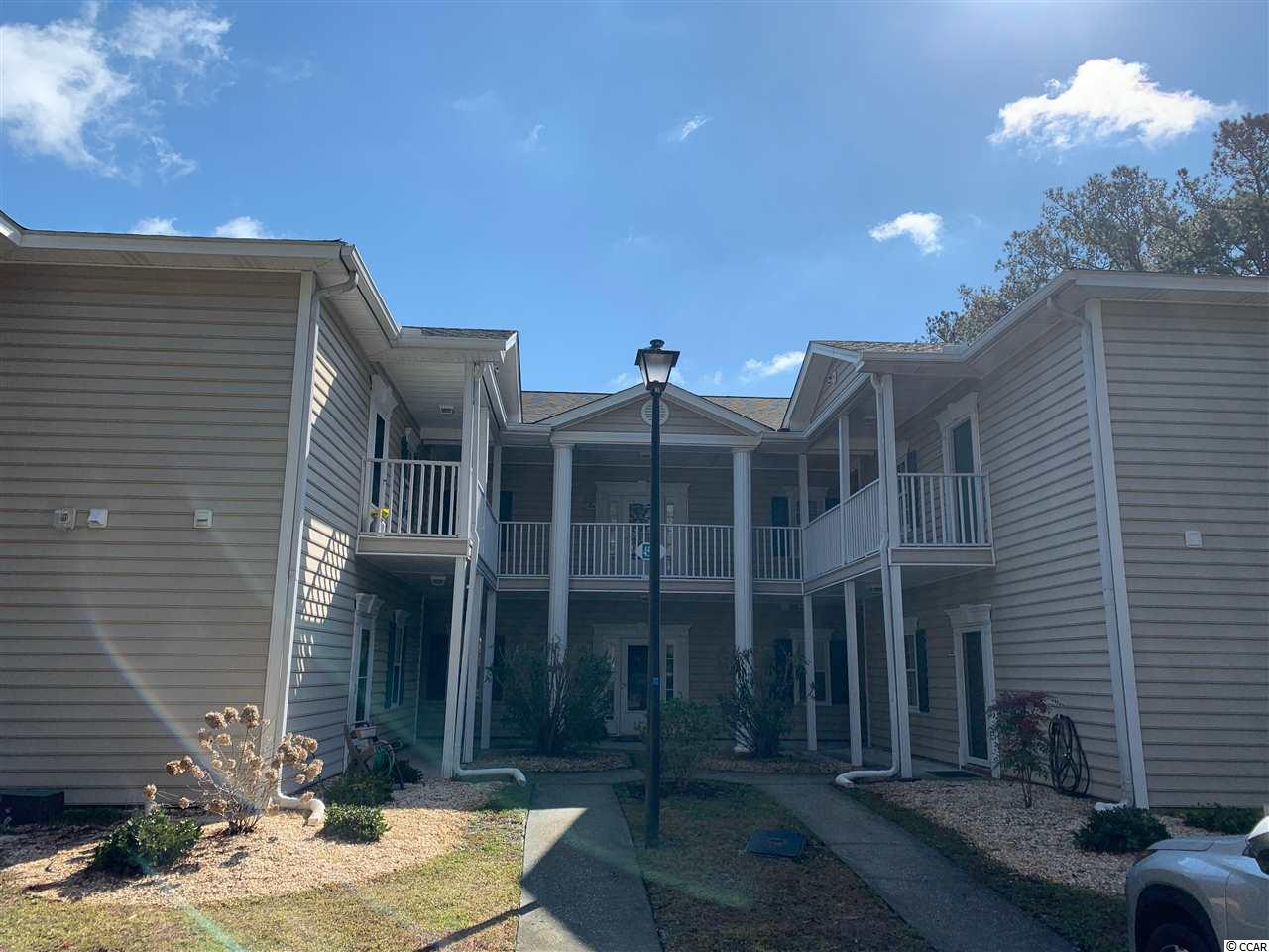 This is a second floor, end unit  2BR 2BA condo that has been freshly painted and carpeted in 2019.  It also features a new microwave, new dishwasher, and AC unit.  Enjoy beach living and all the Murrells Inlet area has to offer.  There is also a onsite pool.